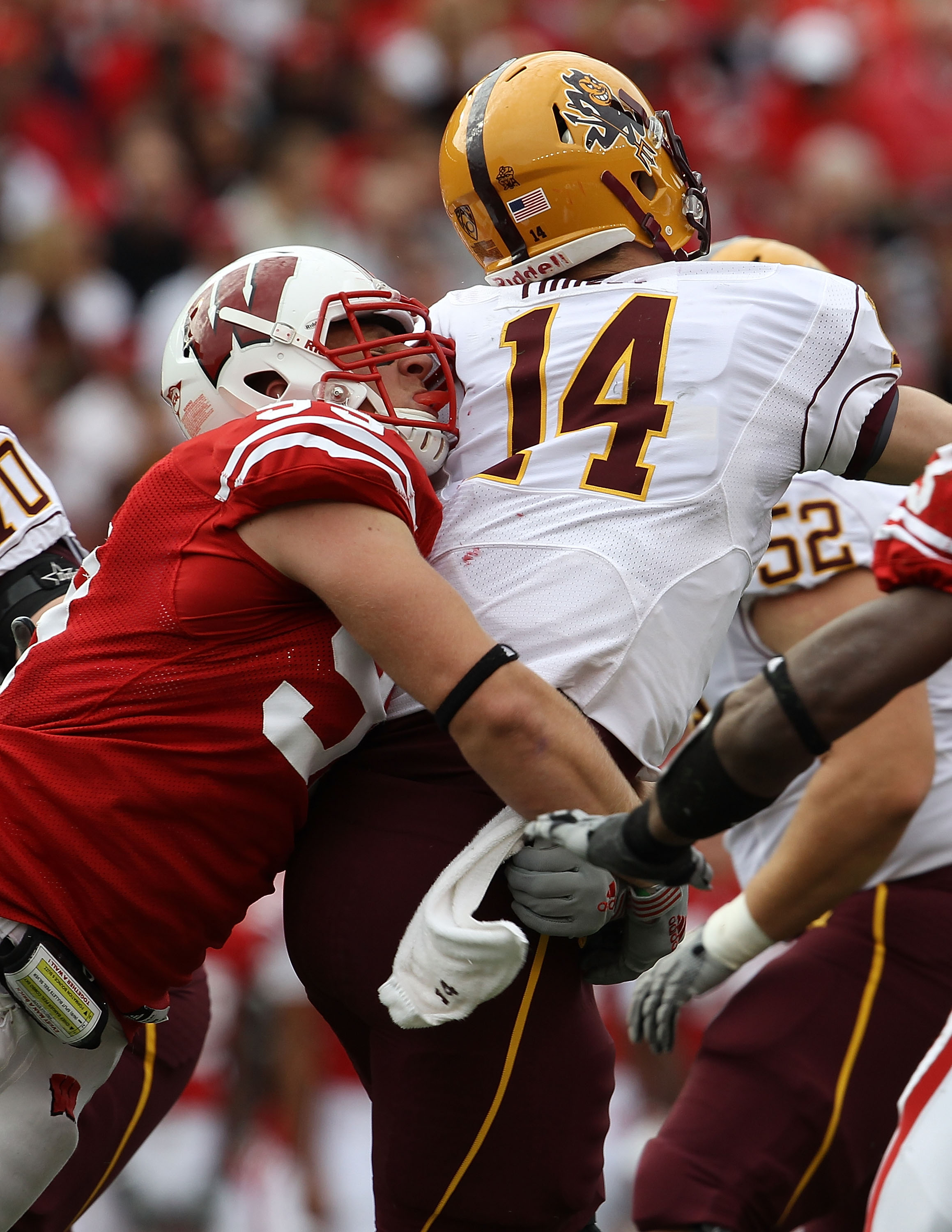 MADISON, WI - SEPTEMBER 18: J.J. Watt #99 of the Wisconsin Badgers hits Steven Threet #14 of the Arizona State Sun Devils at Camp Randall Stadium on September 18, 2010 in Madison, Wisconsin. Wisconsin defeated Arizona State 20-19. (Photo by Jonathan Danie