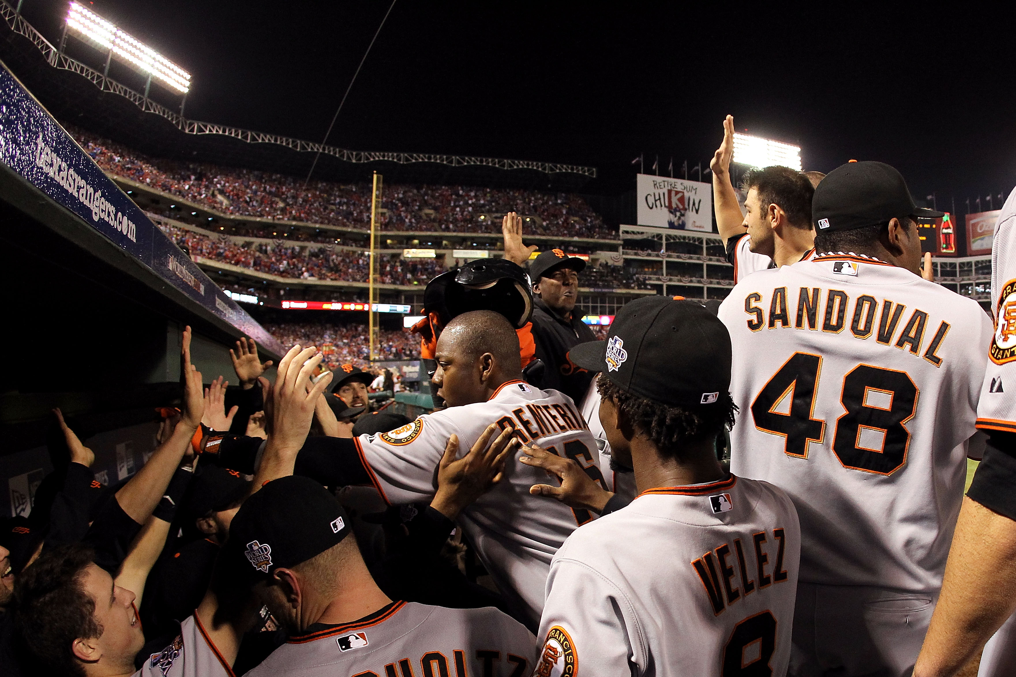 ARLINGTON, TX - NOVEMBER 01:  Edgar Renteria #16 of the San Francisco Giants celebrates with his teammates in the dugout after he hit a 3-run home run in the seventh inning against the Texas Rangers in Game Five of the 2010 MLB World Series at Rangers Bal