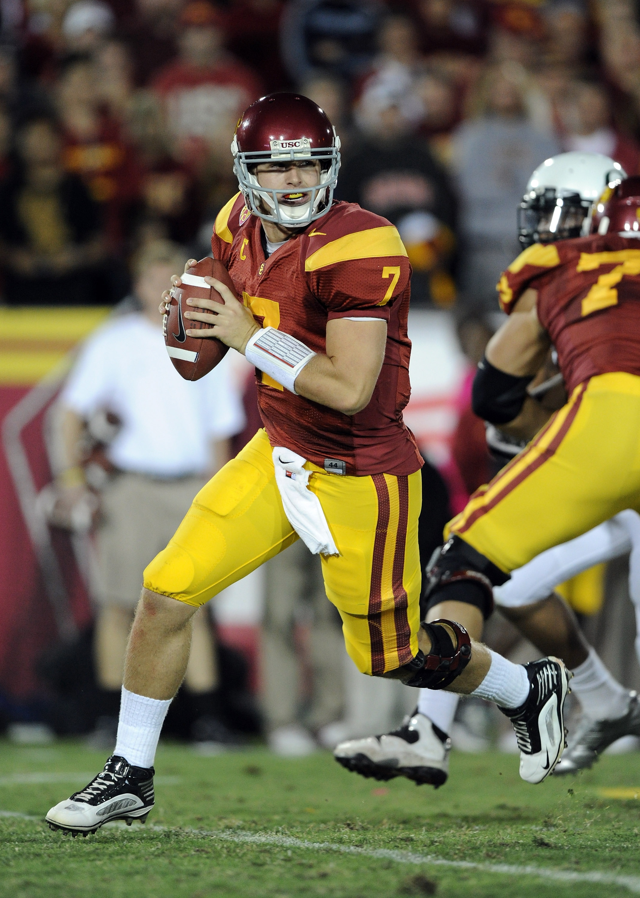 LOS ANGELES, CA - OCTOBER 30:  Matt Barkley #7 of the USC Trojans rolls out of the pocket against the Oregon Ducks at Los Angeles Memorial Coliseum on October 30, 2010 in Los Angeles, California.  (Photo by Harry How/Getty Images)