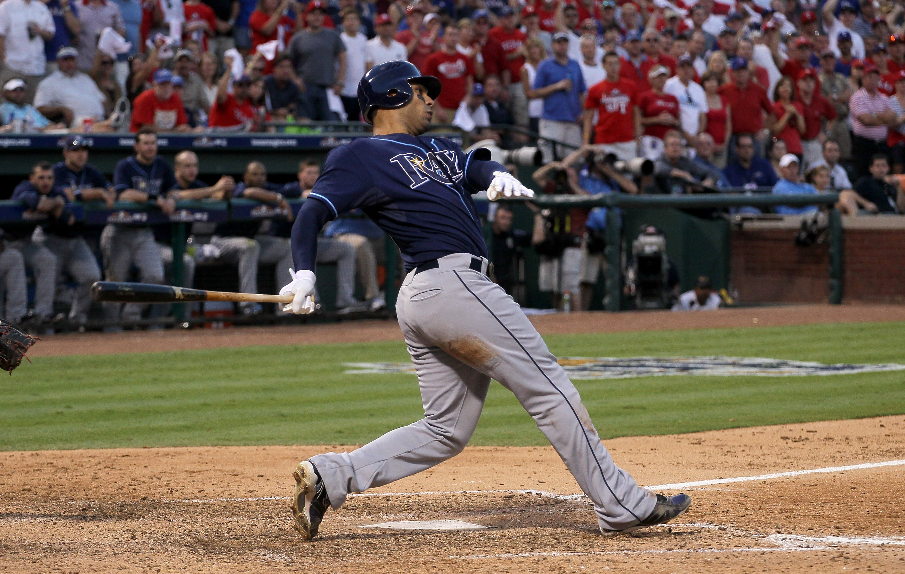 ARLINGTON, TX - OCTOBER 09:  Carlos Pena #23 of the Tampa Bay Rays hits an RBI single in the eighth inning against the Texas Rangers during game three of the ALDS at Rangers Ballpark in Arlington on October 9, 2010 in Arlington, Texas.  The Rays won 6-3.