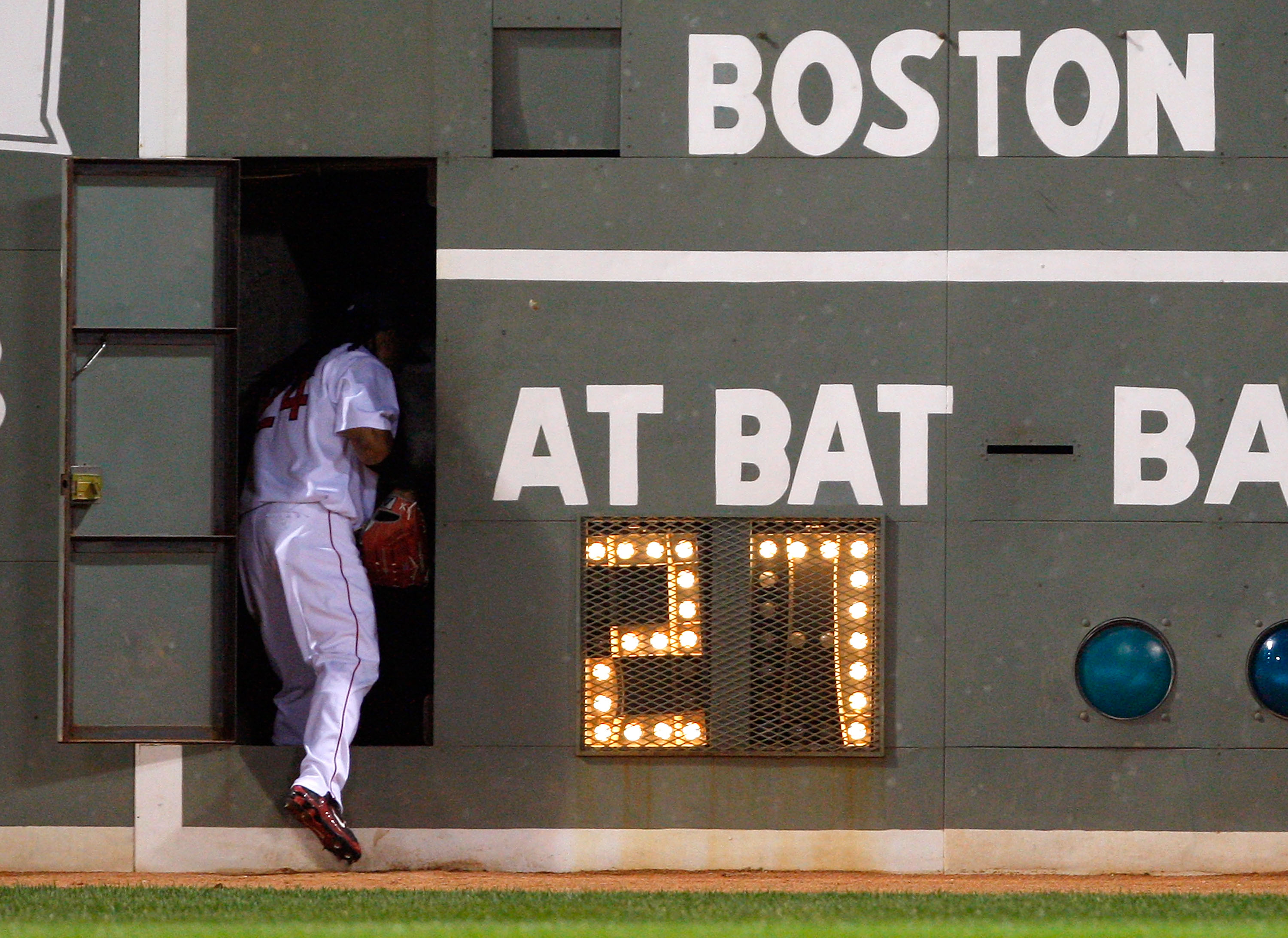BOSTON - JULY 30: Manny Ramirez #24 of the Boston Red Sox heads into the left field wall during a pitching change against the Los Angeles Angels of Anaheim at Fenway Park on July 30, 2008 in Boston, Massachusetts.  (Photo by Jim Rogash/Getty Images)