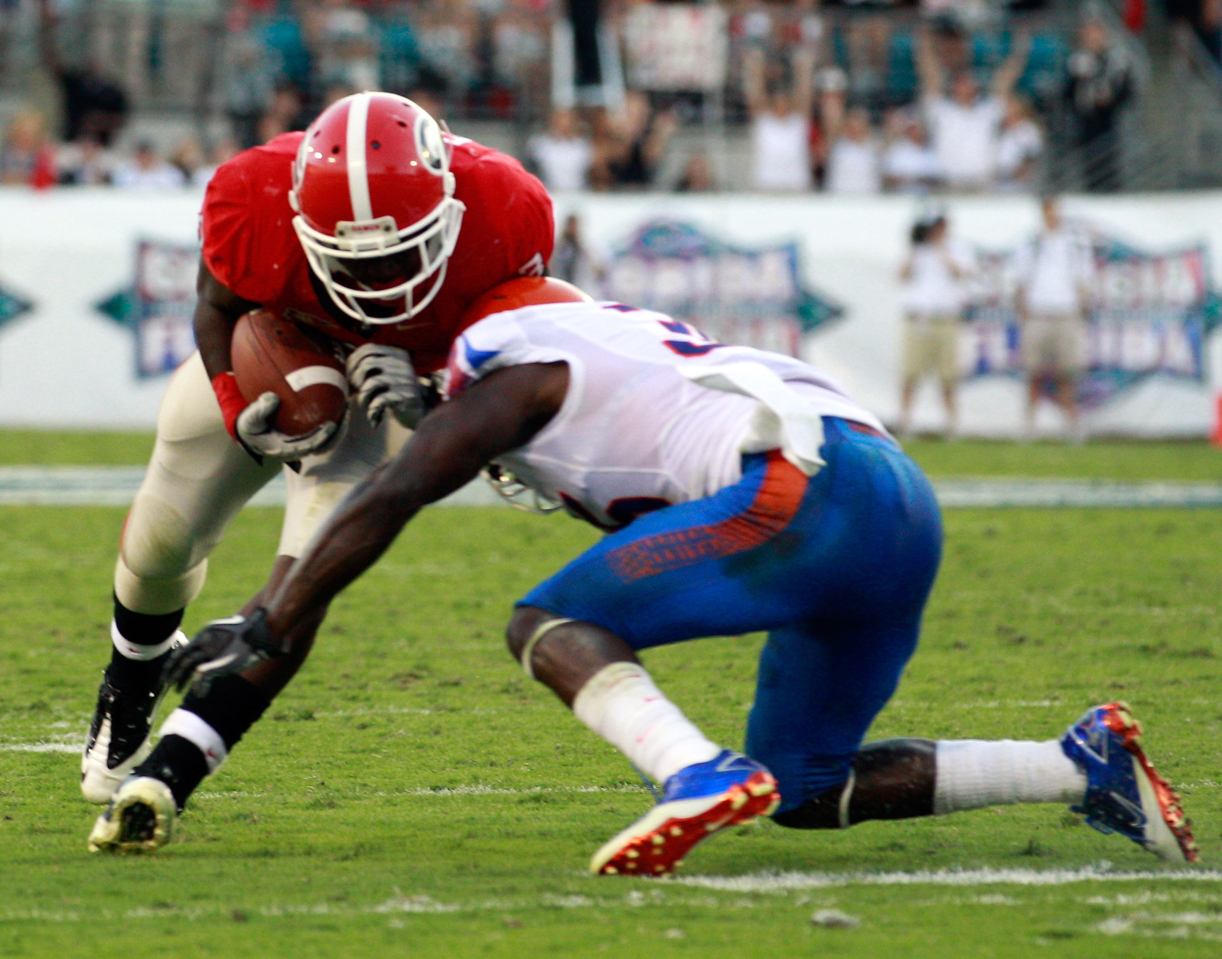 JACKSONVILLE, FL - OCTOBER 30:  Washaun Ealey #3 of the Georgia Bulldogs attempts to run past Ahmad Black #35 of the Florida Gators during the game at EverBank Field on October 30, 2010 in Jacksonville, Florida.  (Photo by Sam Greenwood/Getty Images)