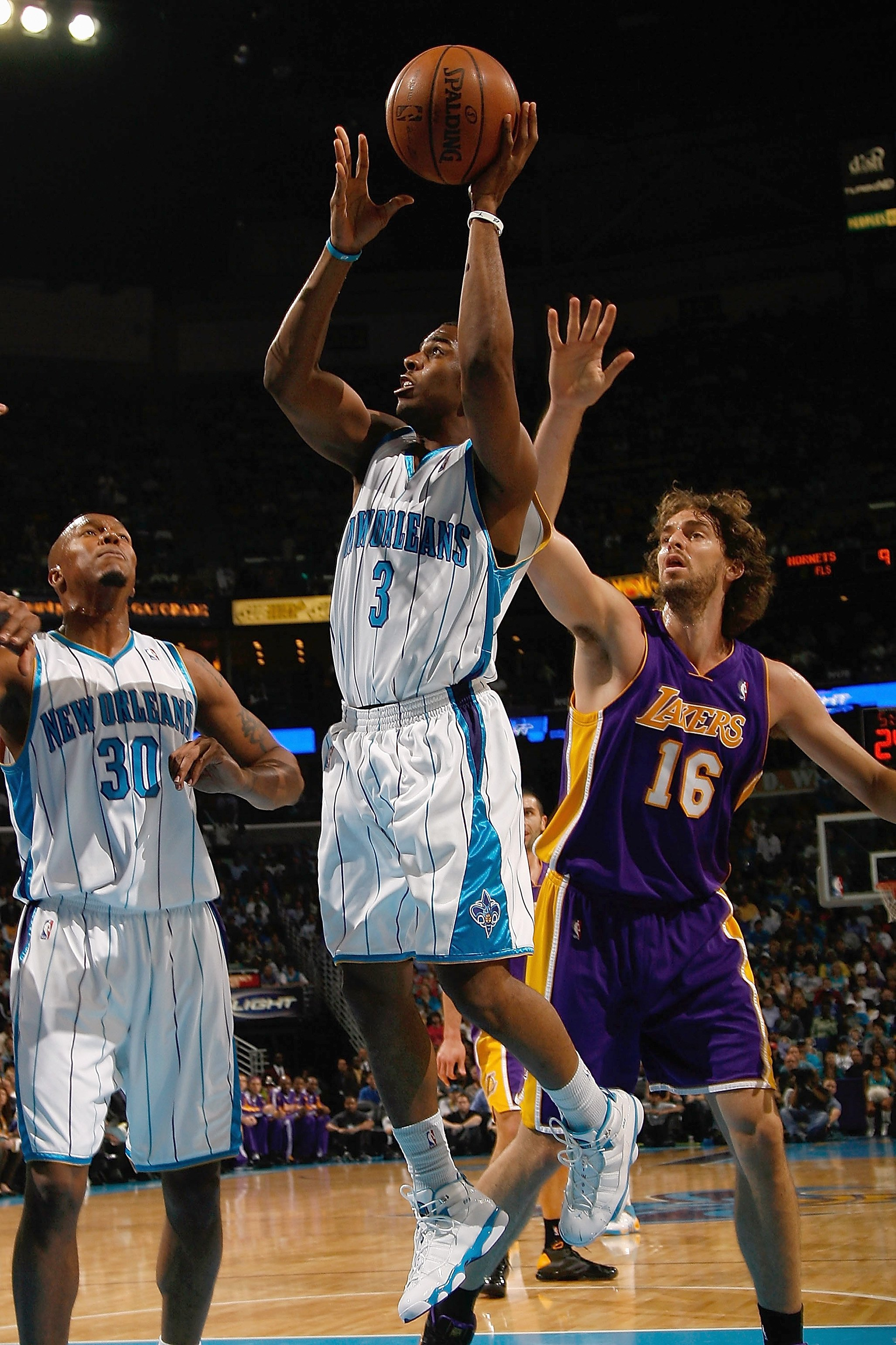 NEW ORLEANS - NOVEMBER 12:  Chris Paul #3 of the New Orleans Hornets looks to shoot against Pau Gasol #16 of the Los Angeles Lakers at the New Orleans Arena on November 12, 2008 in New Orleans, Louisiana. The Lakers won 93-86. NOTE TO USER: User expressly