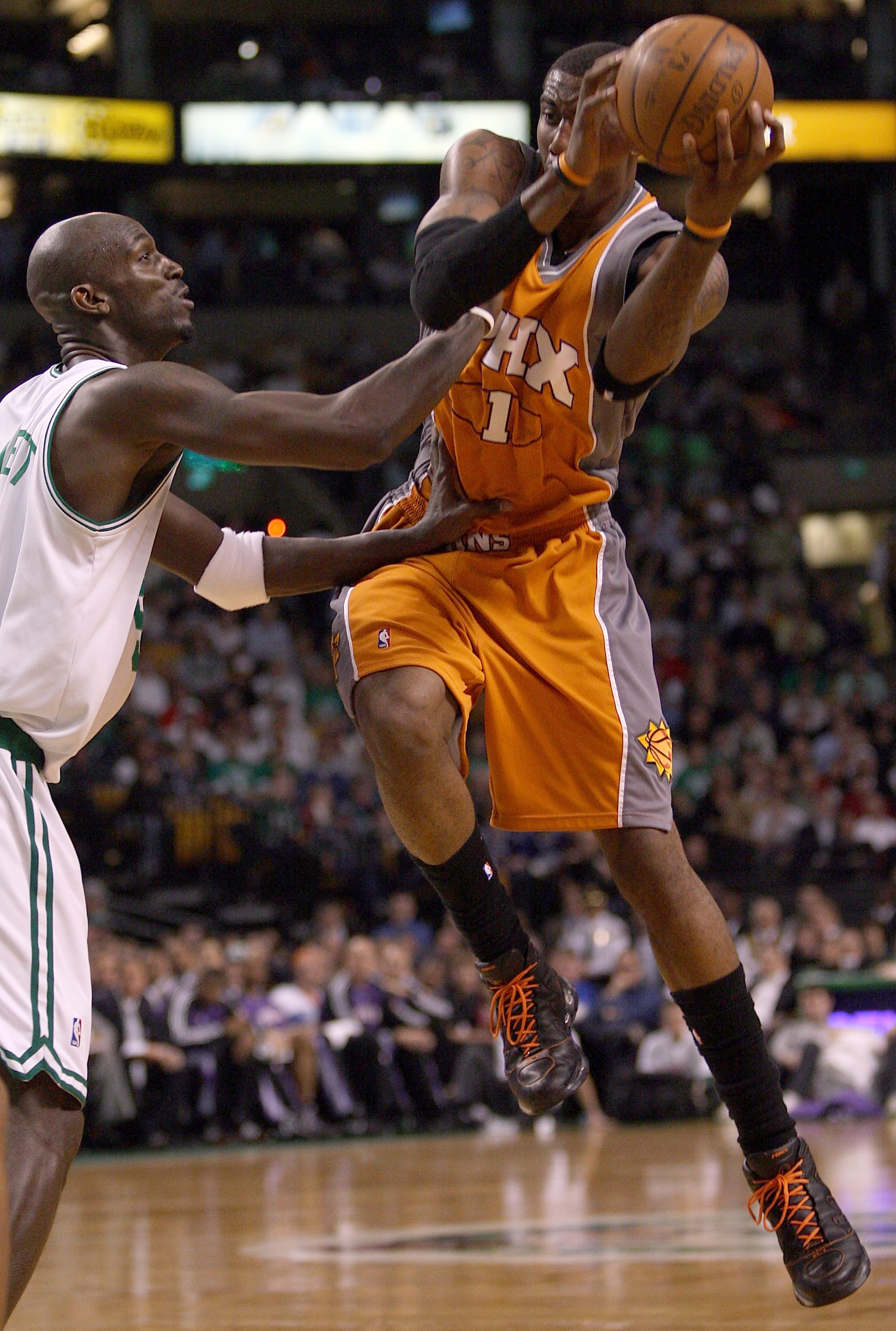 BOSTON - MARCH 26:  Kevin Garnett #5 of the Boston Celtics is unable to nab the loose ball as Amare Stoudemire #1 of the Phoenix Suns catches it on March 26, 2008 at the TD Banknorth Garden in Boston, Massachusetts. The Celtics defeated the Suns 117-97. N