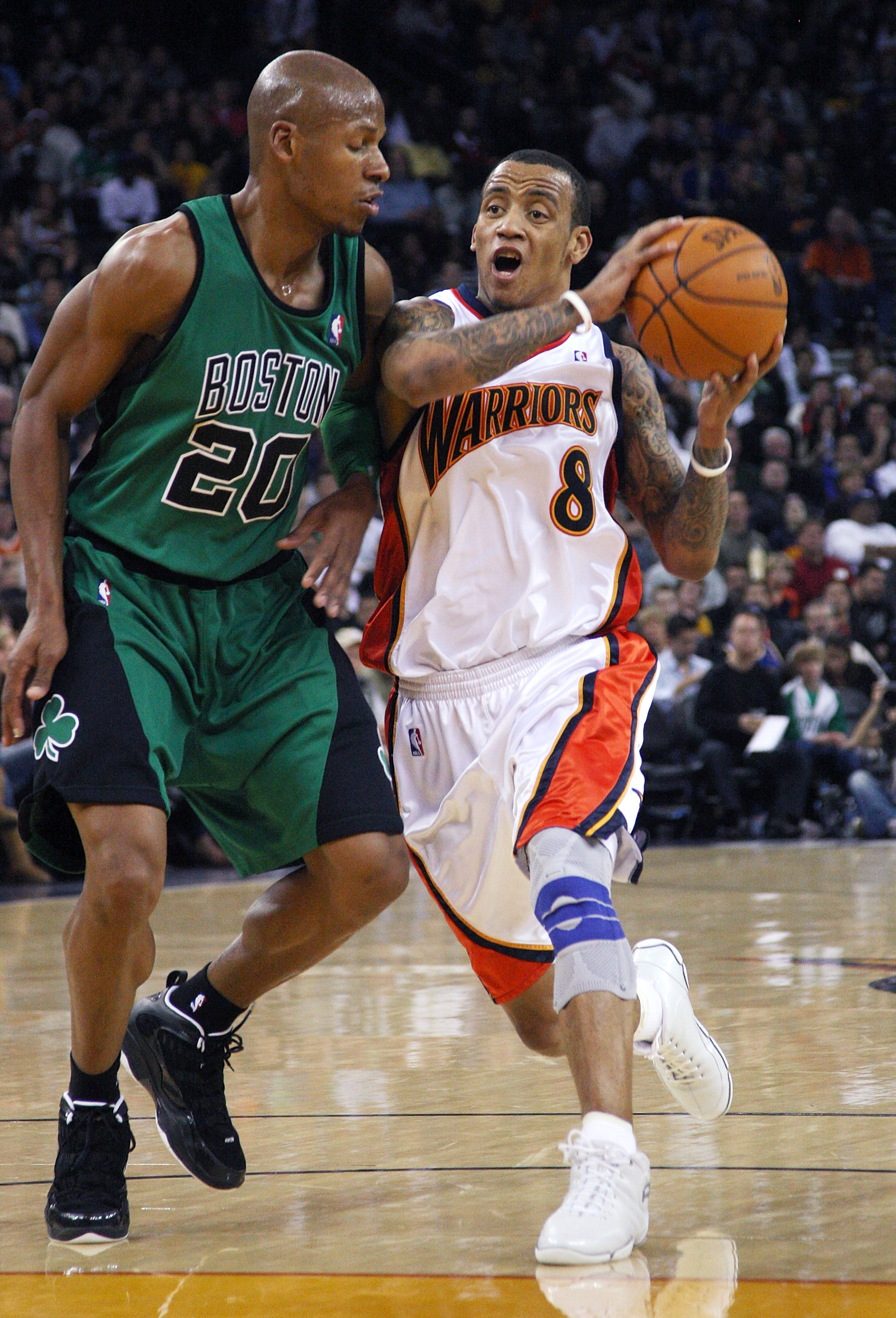 OAKLAND, CA - DECEMBER 28:  Monta Ellis #8 of the Golden State Warriors drives against Ray Allen #20 of the Boston Celtics during an NBA game at Oracle Arena on December 28, 2009 in Oakland, California. NOTE TO USER: User expressly acknowledges and agrees