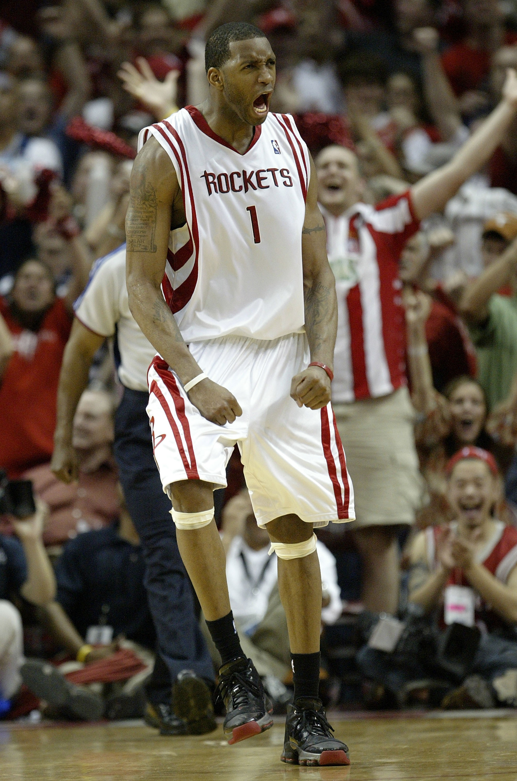 HOUSTON - MAY 5:  Forward Tracy McGrady #1 of the Houston Rockets reacts against the Utah Jazz in Game Seven of the Western Conference Quarterfinals during the 2007 NBA Playoffs at Toyota Center May 5, 2007 in Houston, Texas. NOTE TO USER: User expressly