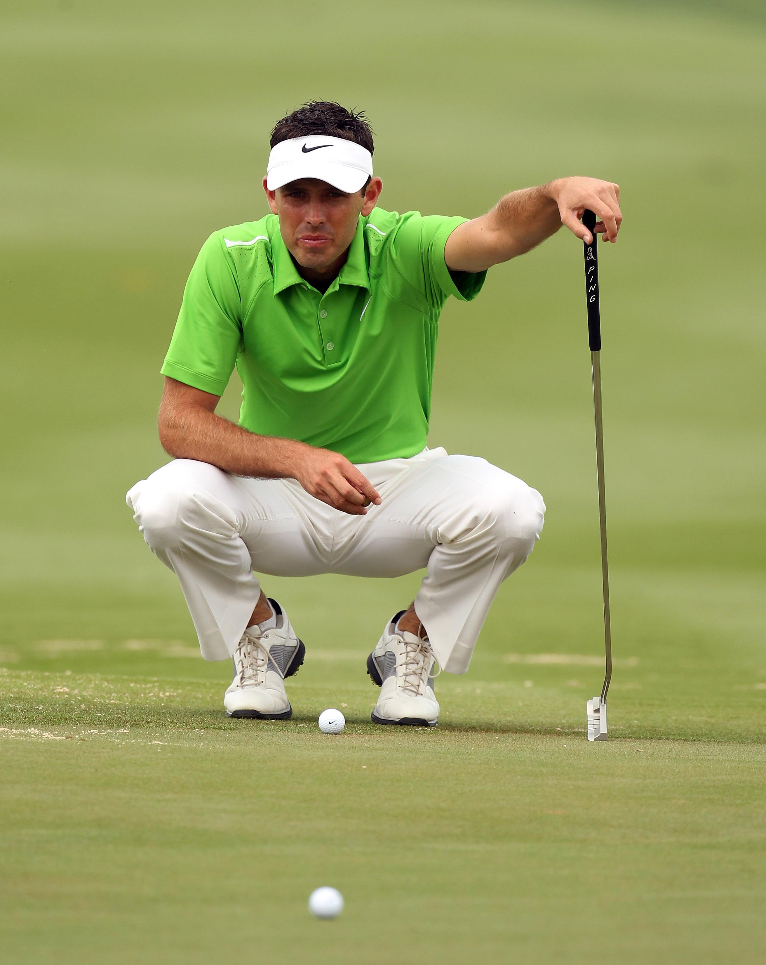 ABU DHABI, UNITED ARAB EMIRATES - JANUARY 22:  Charl Schwartzel of South Africa checks the line of his putt during the third round of the Abu Dhabi HSBC Golf Championship at the Abu Dhabi Golf Club on January 22, 2011 in Abu Dhabi, United Arab Emirates.