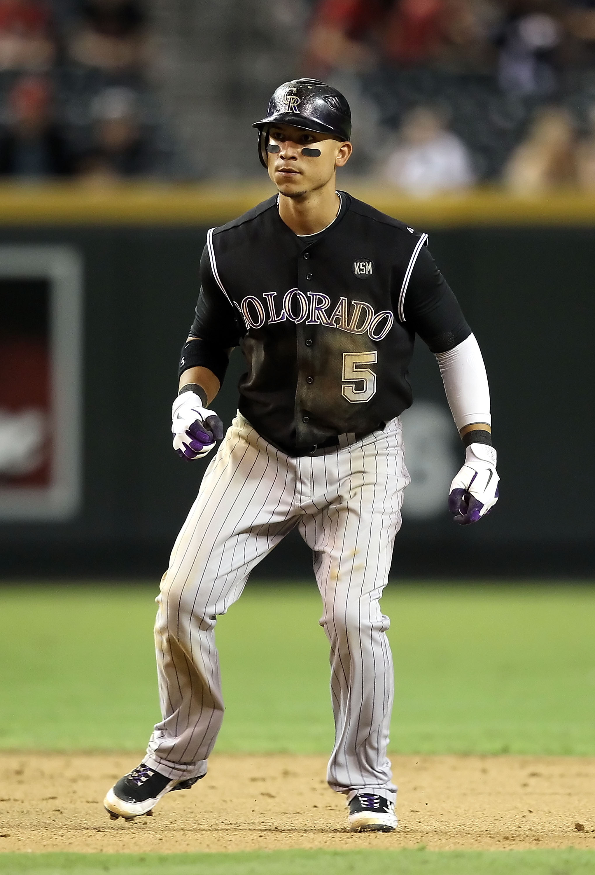 PHOENIX - SEPTEMBER 22:  Carlos Gonzalez #5 of the Colorado Rockies leads off second base during the Major League Baseball game against the Arizona Diamondbacks at Chase Field on September 22, 2010 in Phoenix, Arizona.  (Photo by Christian Petersen/Getty