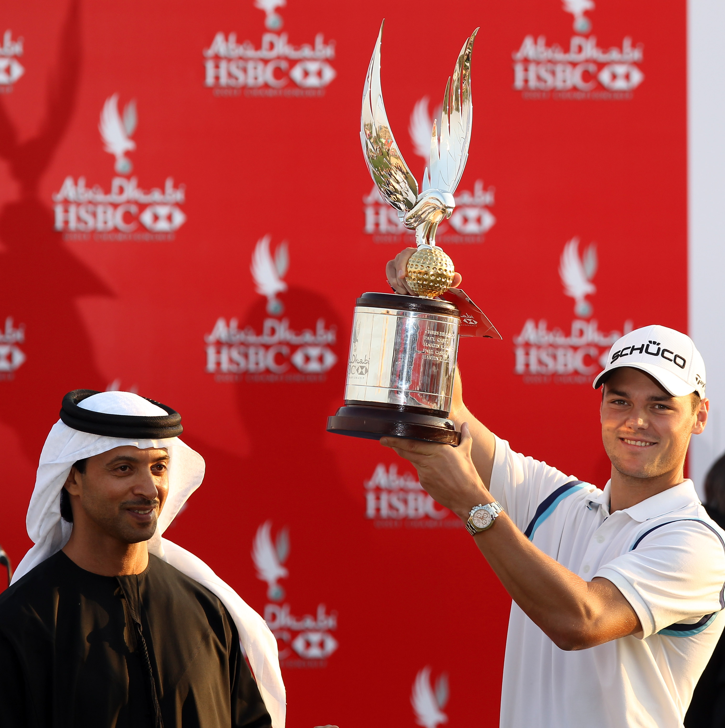 ABU DHABI, UNITED ARAB EMIRATES - JANUARY 23:  Martin Kaymer of Germany is presented with the trophy by His Highness Sheikh Hazza Bin Zayed Al Nahyan The National Security Advisor, Vice Chairman of the Executive Council, and Chairman of the Abu Dhabi Spor