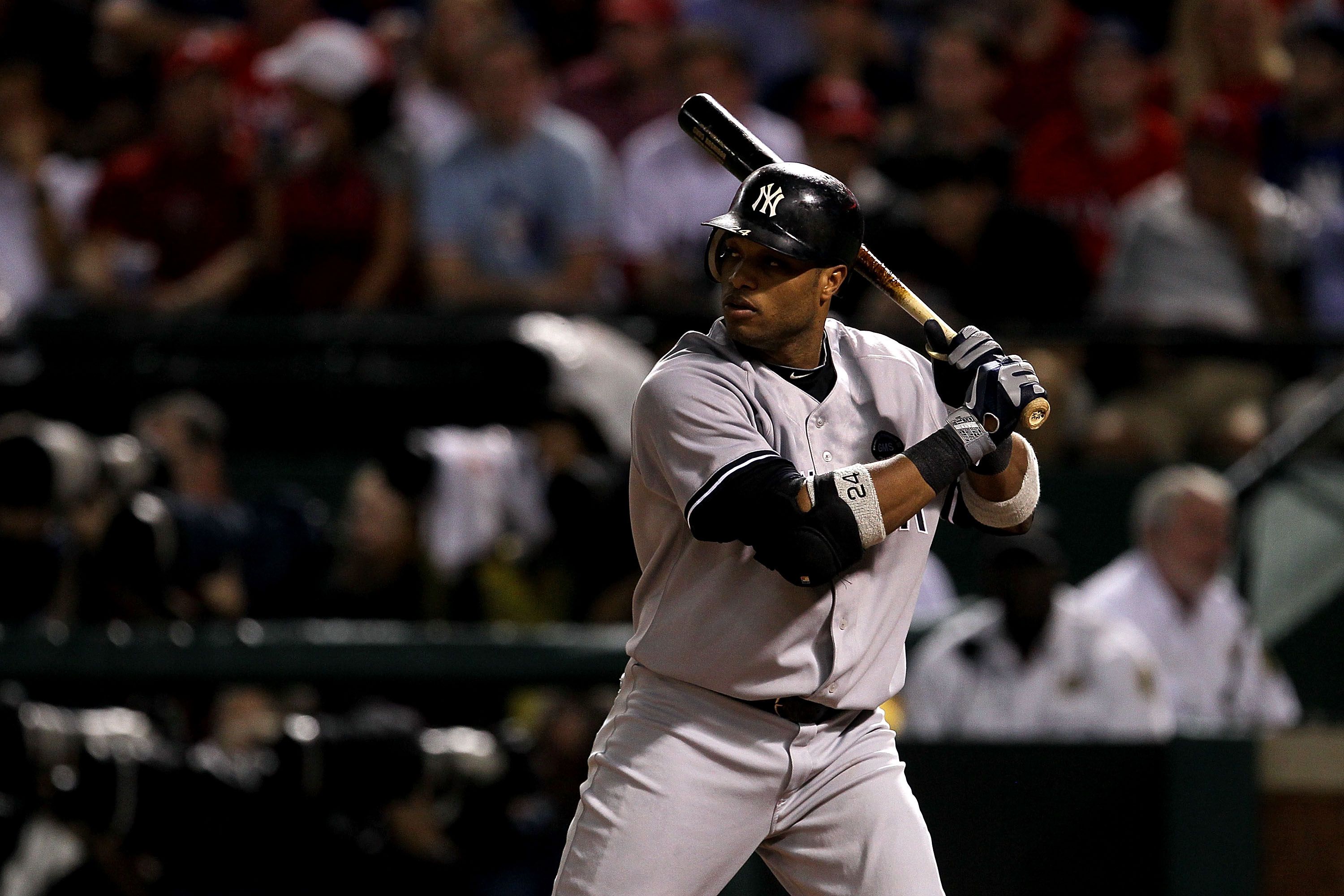 ARLINGTON, TX - OCTOBER 22:  Robinson Cano #24 of the New York Yankees bats against the Texas Rangers in Game Six of the ALCS during the 2010 MLB Playoffs at Rangers Ballpark in Arlington on October 22, 2010 in Arlington, Texas. The Rangers won 6-1.  (Pho