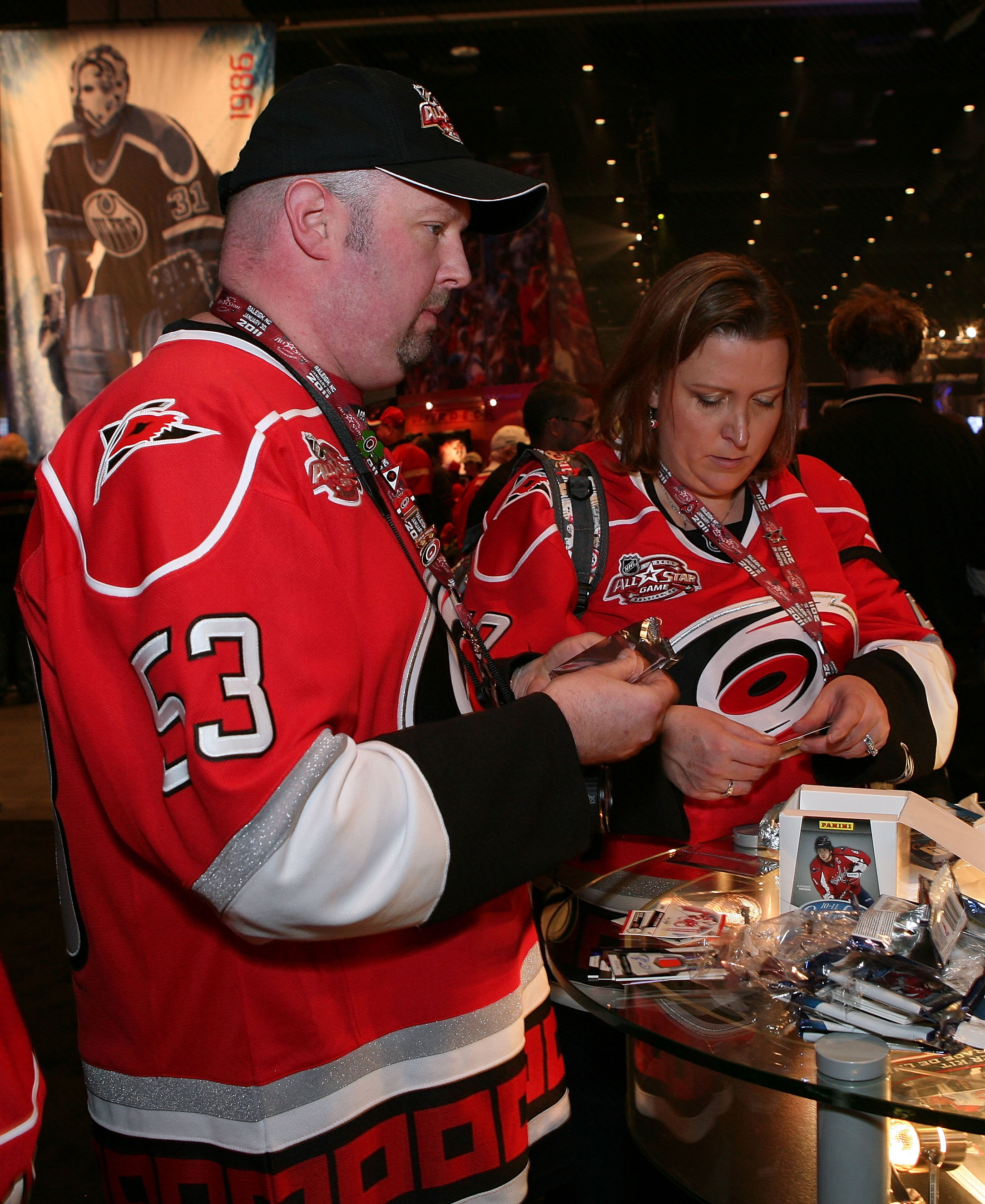 RALEIGH, NC - JANUARY 28:  Fans go through packs of NHL trading cards inside the NHL Fan Fair part of 2011 NHL All-Star Weekend at the Raleigh Convention Center on January 28, 2011 in Raleigh, North Carolina.  (Photo by Bruce Bennett/Getty Images)