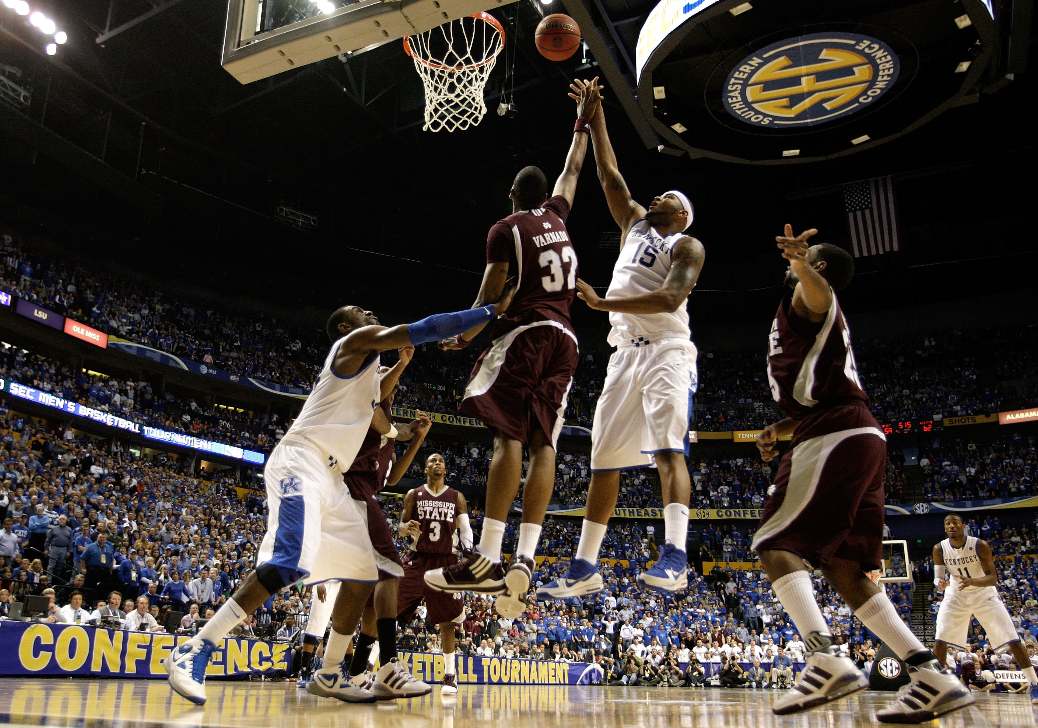 NASHVILLE, TN - MARCH 14:  DeMarcus Cousins #15 of the Kentucky Wildcats attempts a shot against Jarvis Varnado #32 of the Mississippi State Bulldogs during the final of the SEC Men's Basketball Tournament at the Bridgestone Arena on March 14, 2010 in Nas