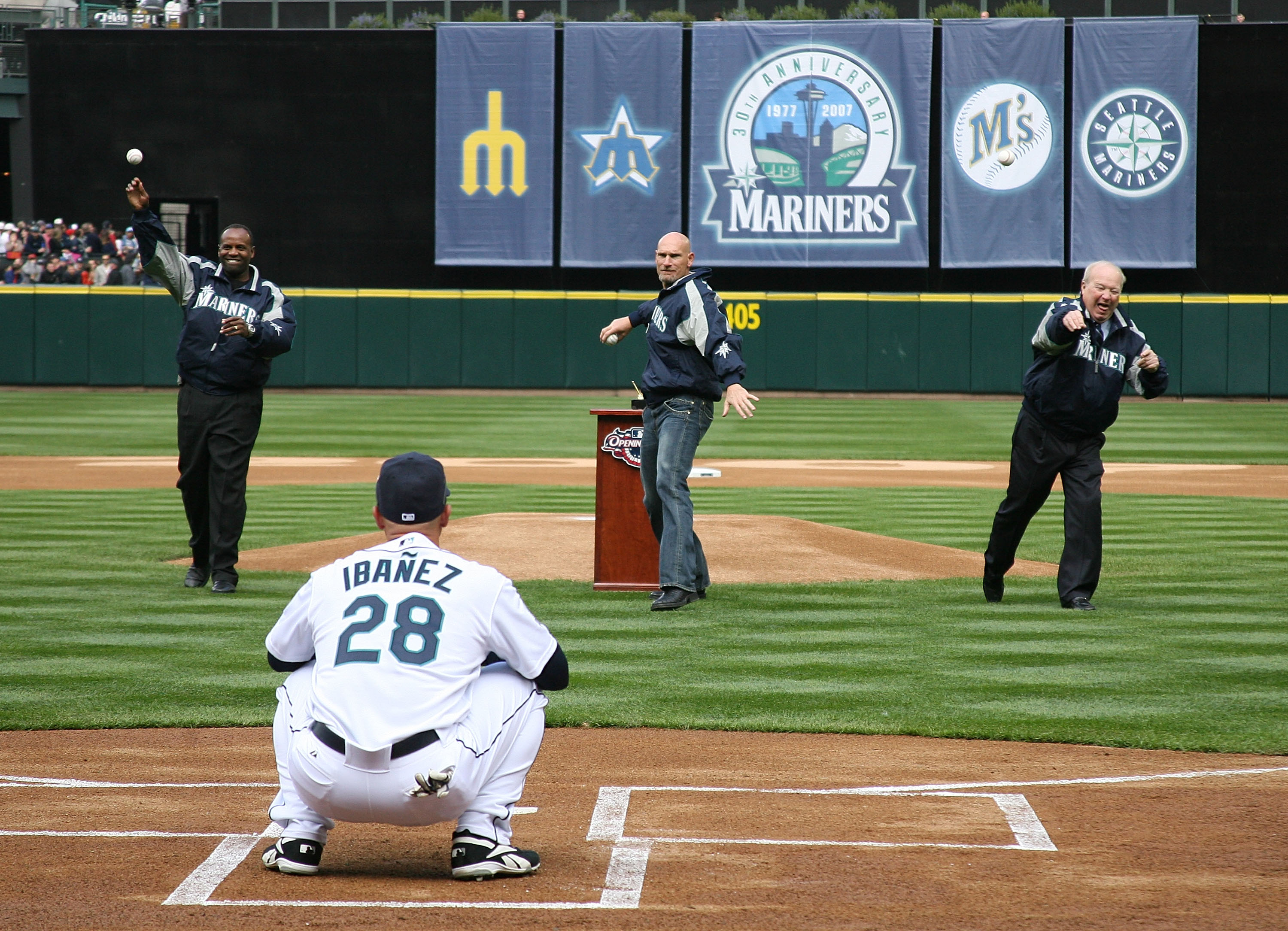 SEATTLE - APRIL 2:  (L-R) Former Mariners Alvin Davis, Jay Buhner, and team announcer Dave Niehaus of the Seattle Mariners throw out the ceremonial first pitch of the game on opening day against the Oakland A's at Safeco Field April 2, 2007 in Seattle, Wa