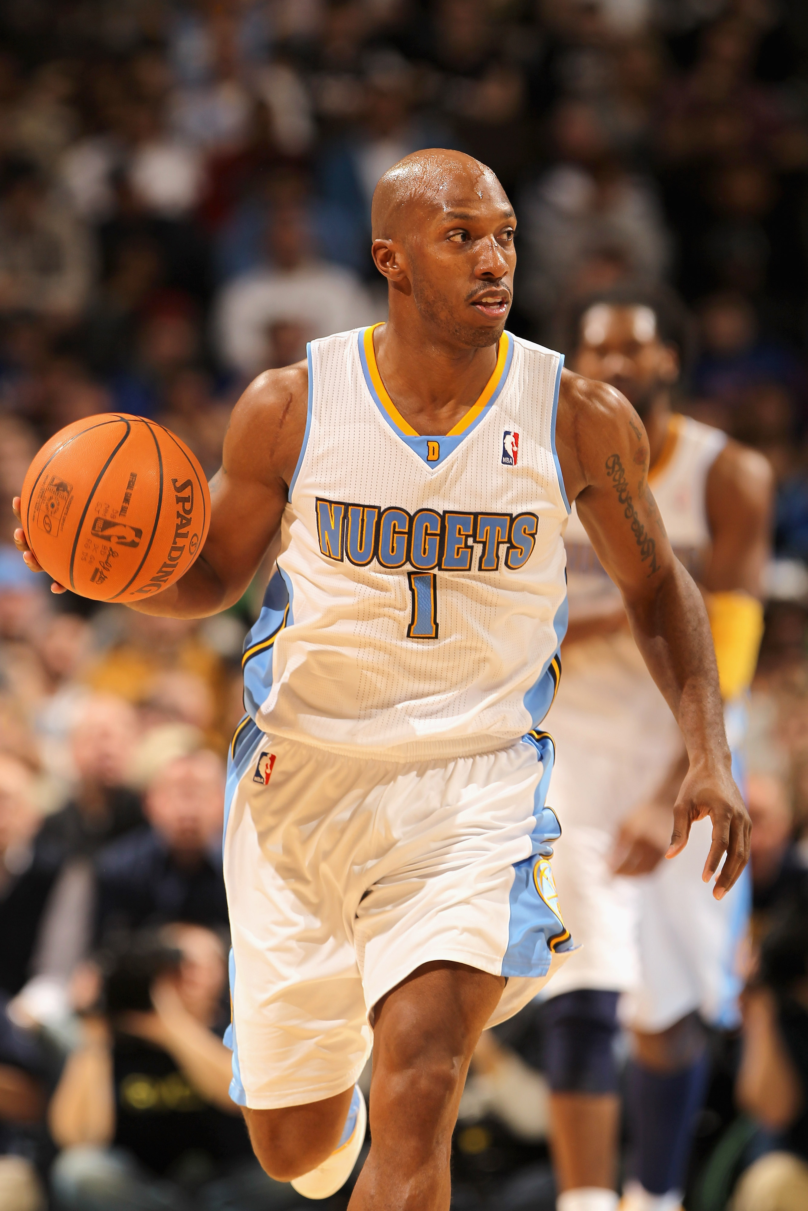 DENVER, CO - JANUARY 13:  Chauncey Billups #1 of the Denver Nuggets dribbles the ball upcourt against the Miami Heat at the Pepsi Center on January 13, 2011 in Denver, Colorado. The Nuggets defeated the Heat 130-102. NOTE TO USER: User expressly acknowled