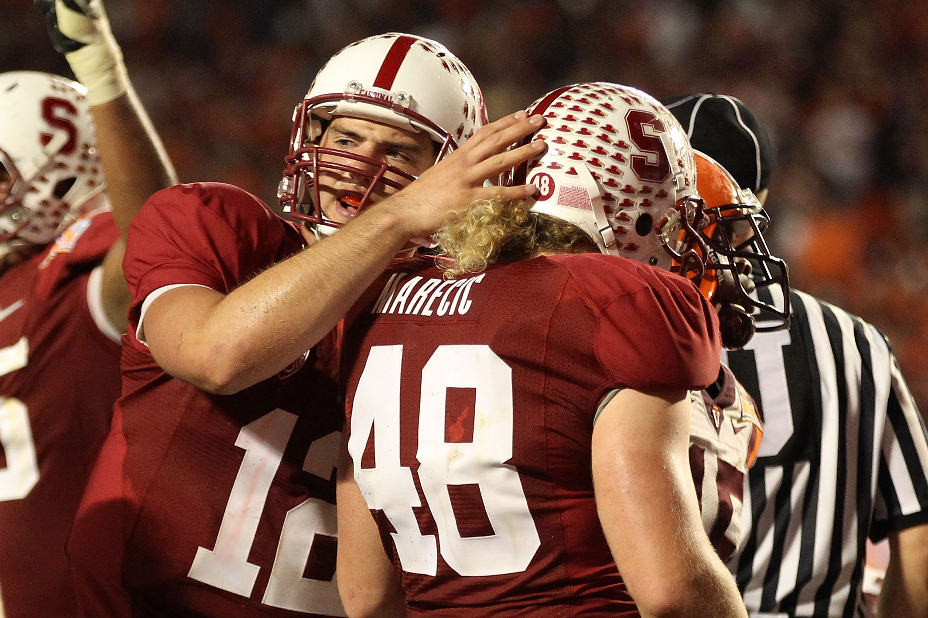 MIAMI, FL - JANUARY 03: (L-R) Andrew Luck #12 and Owen Marecic #48 of the Stanford Cardinal celebrate after Marecic scored a 1-yard rushing touchdown in the third quarter against the Virginia Tech Hokies during the 2011 Discover Orange Bowl at Sun Life St