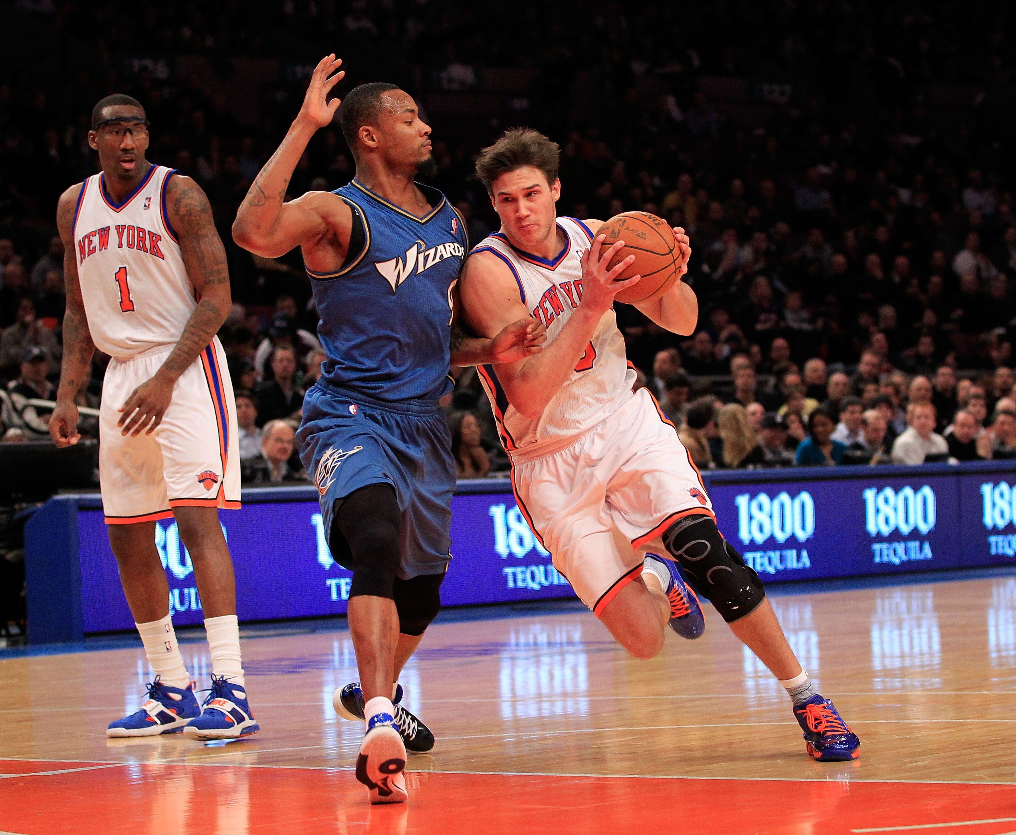 NEW YORK, NY - JANUARY 24: Danilo Gallinari #8 of the New York Knicks drives past Rashard Lewis #9 of the Washington Wizards at Madison Square Garden on January 24, 2011 in New York City. NOTE TO USER: User expressly acknowledges and agrees that, by downl