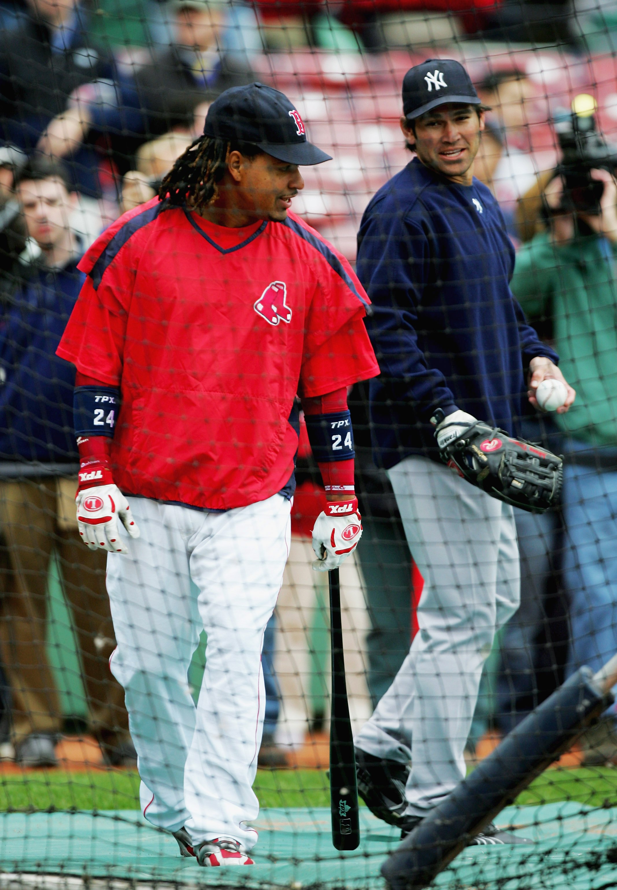 BOSTON - MAY 01:  Johnny Damon of the New York Yankees talks with former teammate Manny Ramirez of the Boston Red Sox at Fenway Park May 1, 2006 in Boston, Massachusetts.  (Photo by Ezra Shaw/Getty Images)