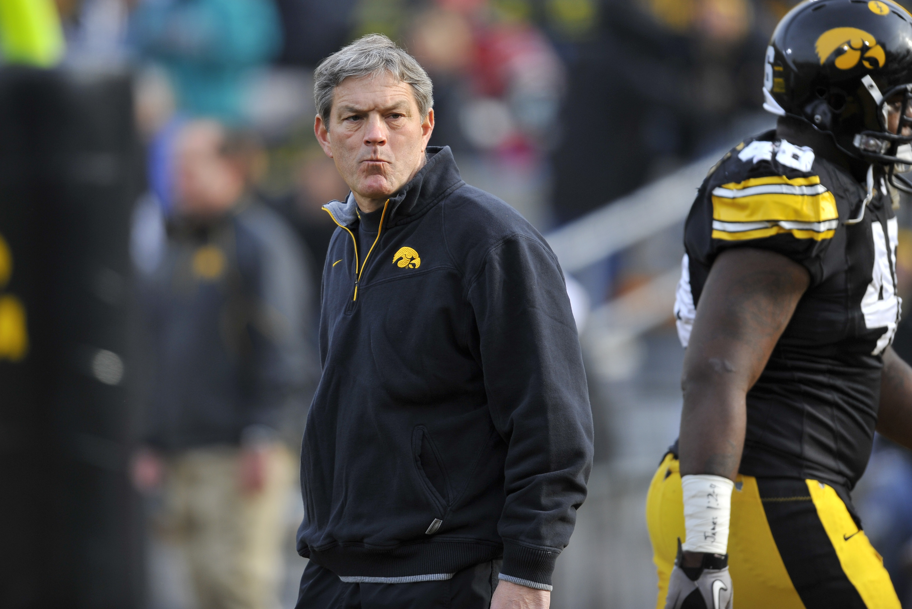IOWA CITY, IA - NOVEMBER 20: University of Iowa Hawkeyes head coach Kirk Ferentz looks on from the sideline during pre game warm ups before game action against the Ohio State Buckeyes at Kinnick Stadium on November 20, 2010 in Iowa City, Iowa. Ohio State