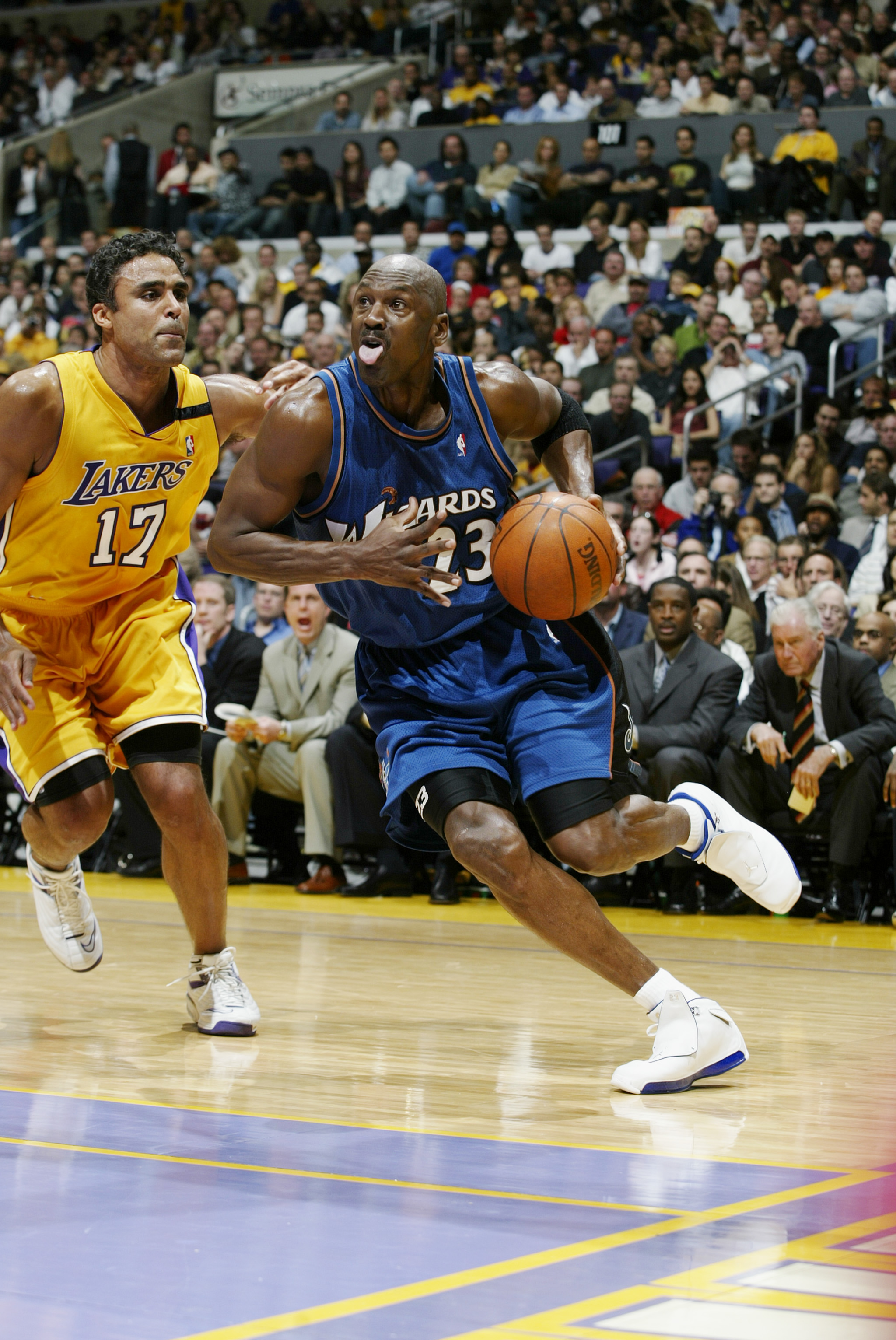 LOS ANGELES - MARCH 28:  Michael Jordan #23 of the Washington Wizards drives past Rick Fox #17 of the Los Angeles Lakers during the game at Staples Center on March 28, 2003 in Los Angeles, California.  The Lakers won 108-94.  NOTE TO USER: User expressly