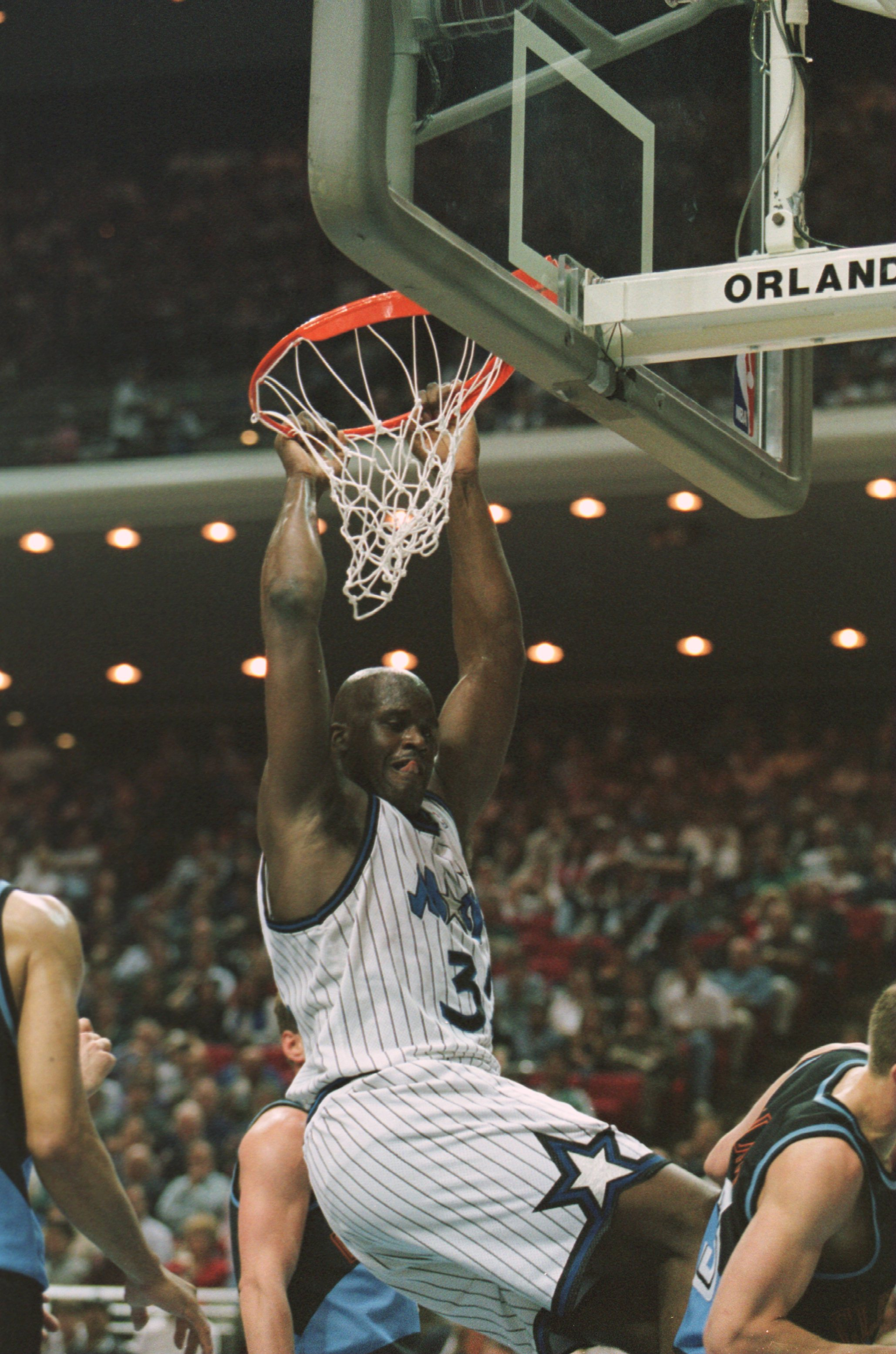 10 Apr 1996:  Center Shaquille O''Neal of the Orlando Magic hangs from the rim as he completes a slam dunk during the Magic''s 116-104 victory over the Cleveland Cavaliers at the Orlando Arena in Orlando, Florida.   Mandatory Credit: Allsport USA/ALLSPORT
