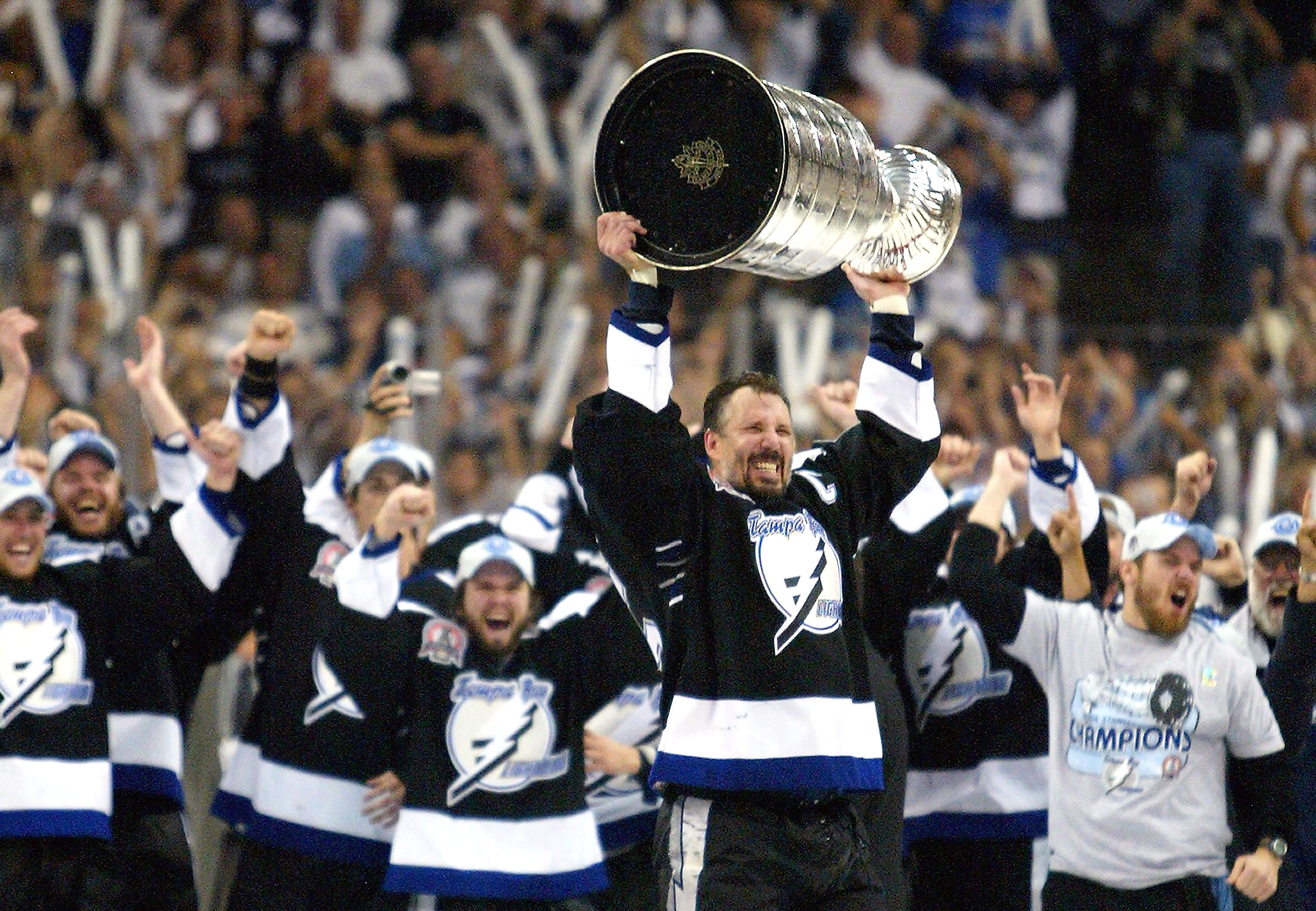 TAMPA, FL - JUNE 7:   Dave Andreychuk #25 of the Tampa Bay Lightning skates with the Stanley Cup after defeating the Calgary Flames in game seven of the NHL Stanley Cup Finals on June 7, 2004 at the St. Pete Times Forum in Tampa, Florida.  The Lightning w