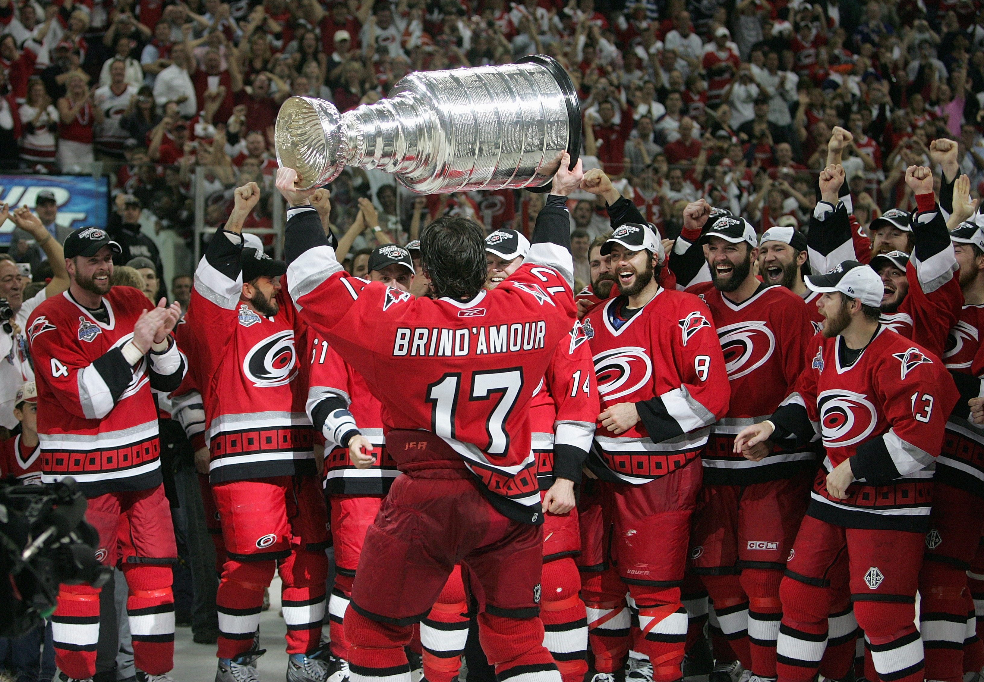 RALEIGH, NC - JUNE 19:  Rod Brind'Amour #17 of the Carolina Hurricanes hoists the Stanley Cup in front of his teammates after the Hurricanes defeated the Edmonton Oilers in game seven of the 2006 NHL Stanley Cup Finals on June 19, 2006 at the RBC Center i