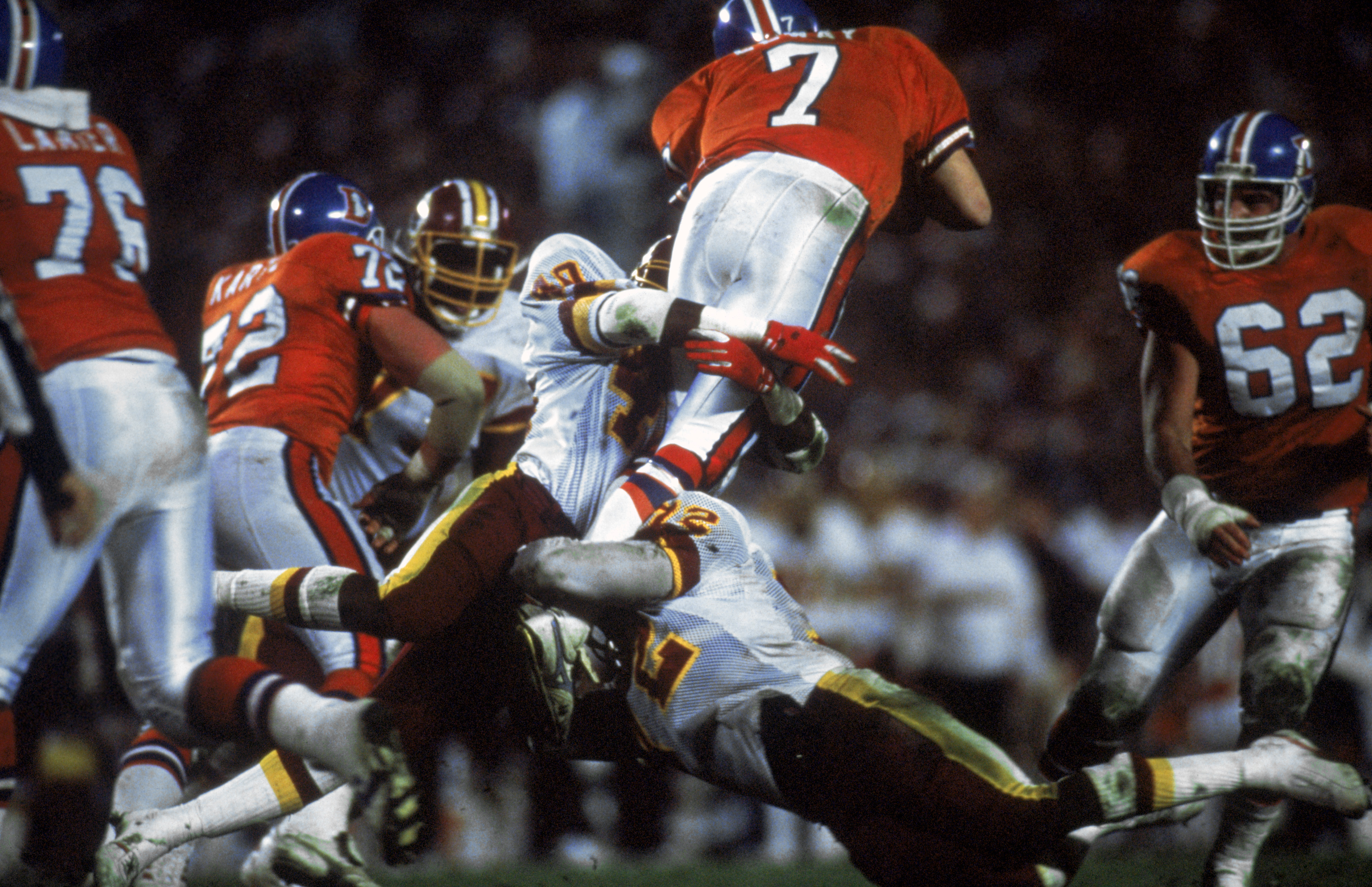SAN DIEGO - JANUARY 31:  Dexter Manley #72 of the Washington Redskins assists in tackling quarterback John Elway #7 of the Denver Broncos during Superbowl XXII on January 31, 1988 at San Diego Jack Murphy Stadium in San Diego, California.  The Redskins de