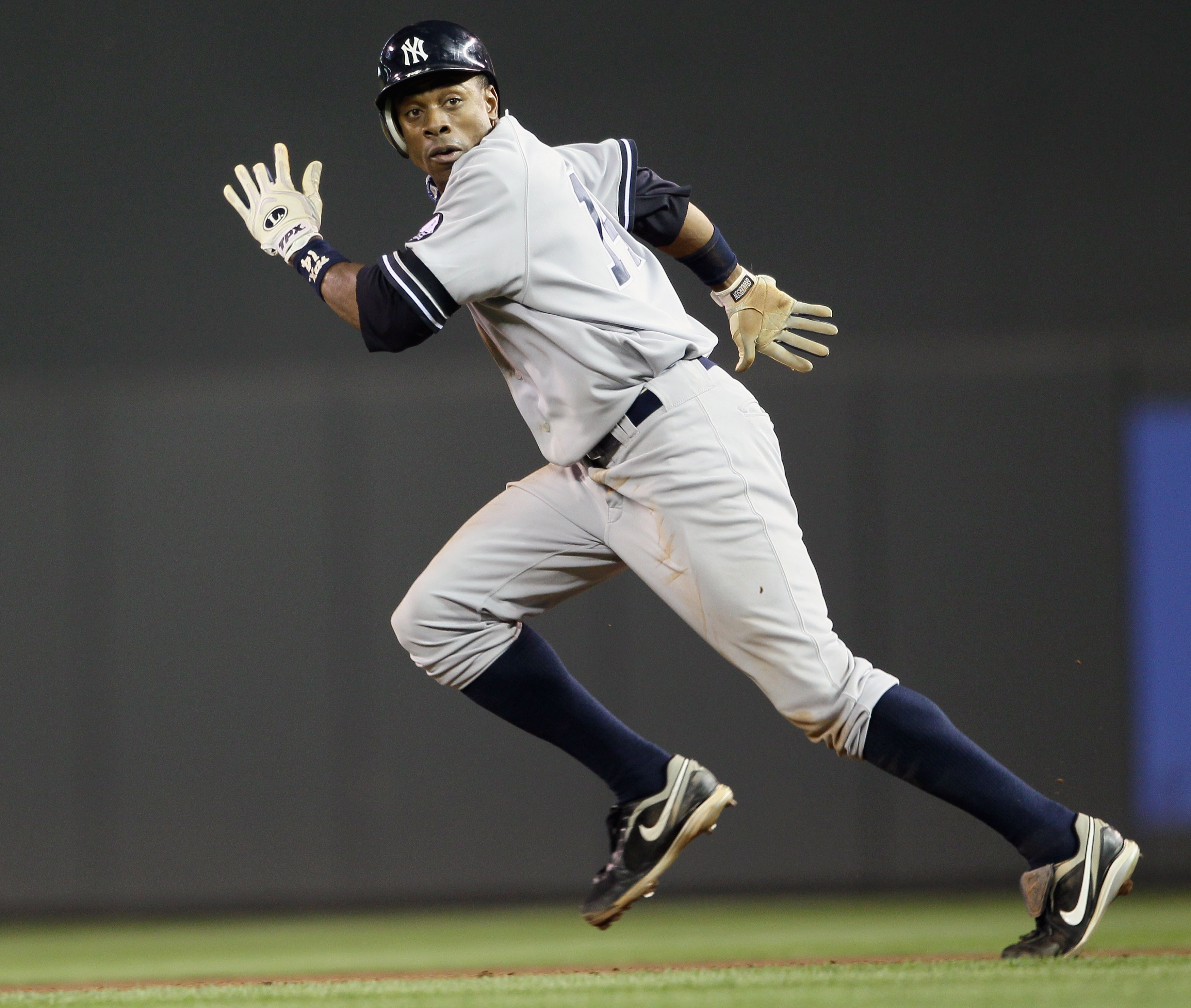 MINNEAPOLIS - OCTOBER 07:  Curtis Granderson #14 of the New York Yankees runs to second base against the Minnesota Twins during game two of the ALDS on October 7, 2010 at Target Field in Minneapolis, Minnesota. The Yankees beat the Twins 5-2.(Photo by Els