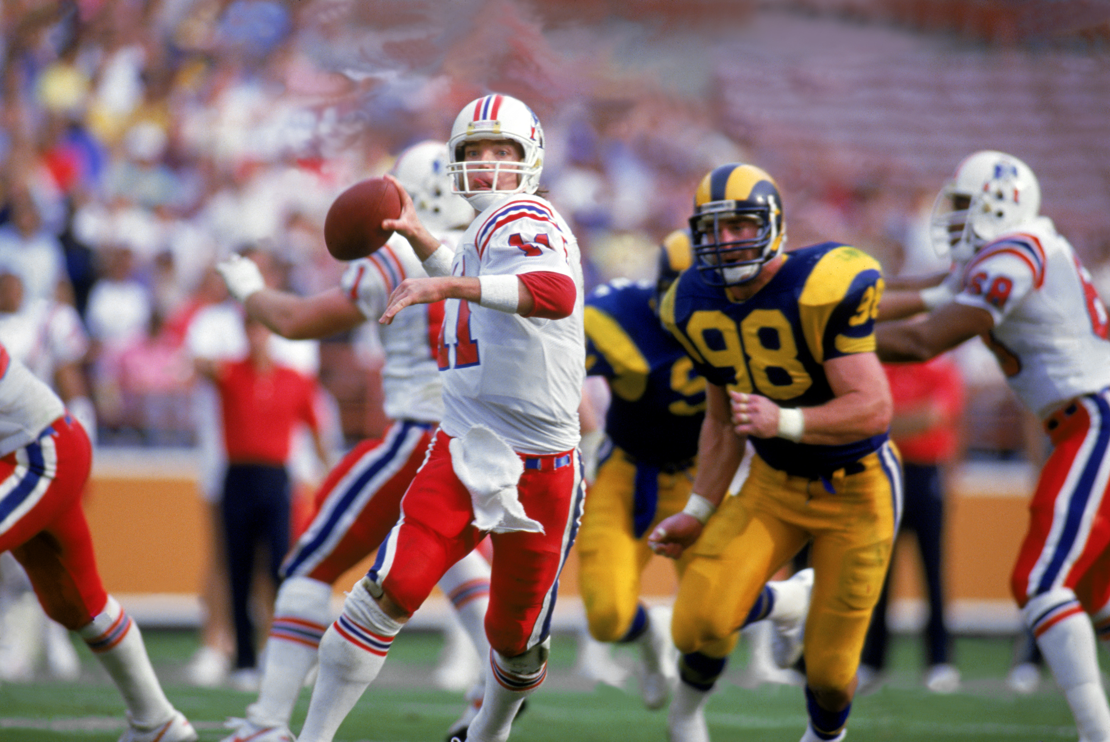 LOS ANGELES - 1986:  Quarterback Tony Eason #11 of the New England Patriots rolls out under pressure during a 1986 NFL game against the Los Angeles Rams at LA Memorial Coliseum in Los Angeles, California.  The Pats defeated the Rams 30-28.  (Photo by Tony