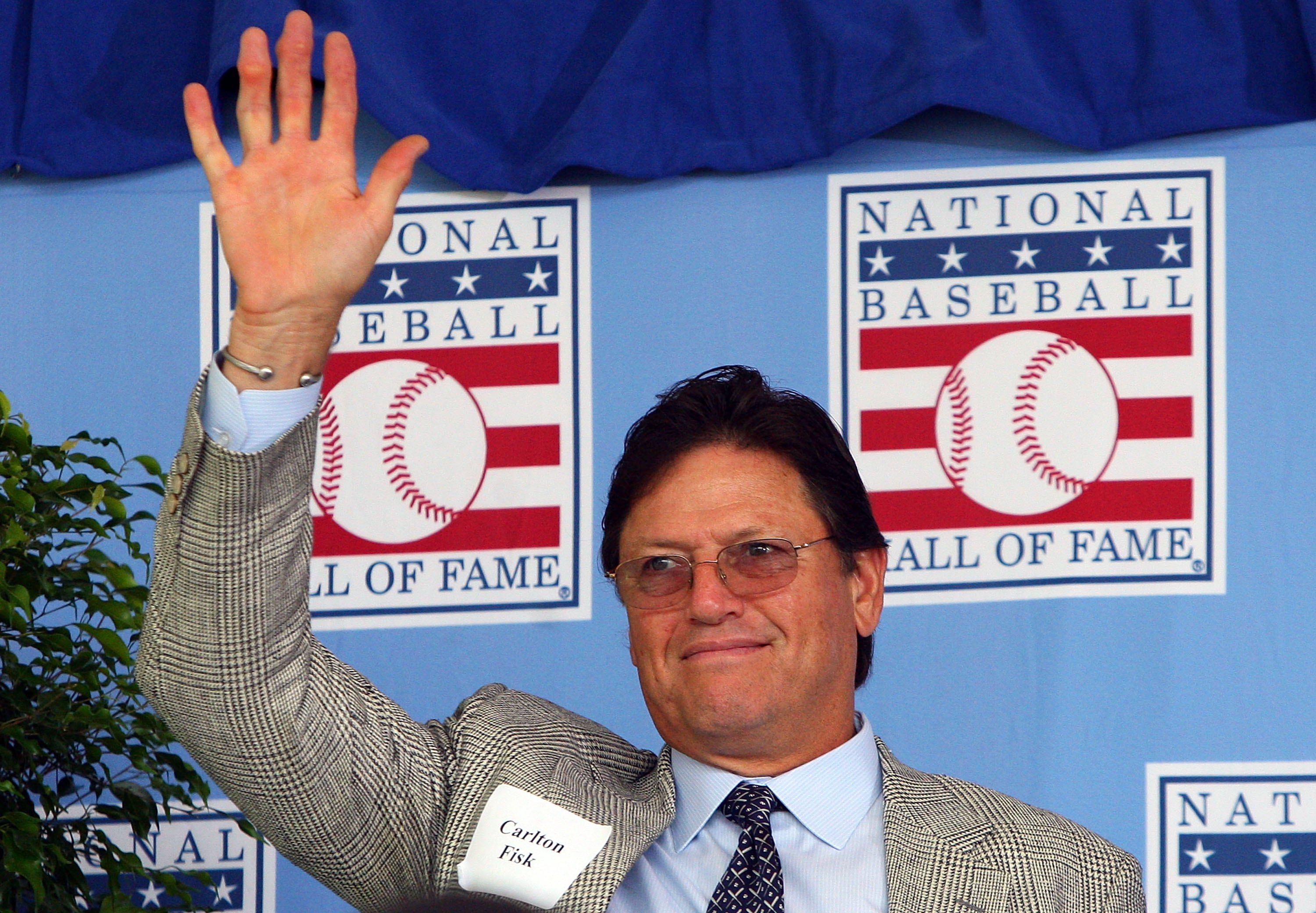 COOPERSTOWN, NY - JULY 26:  Hall of Famer Carlton Fisk waves to the crowd as he is introduced at Clark Sports Center during the 2009  Baseball Hall of Fame induction ceremony on July 26, 2009 in Cooperstown, New York.  (Photo by Jim McIsaac/Getty Images)