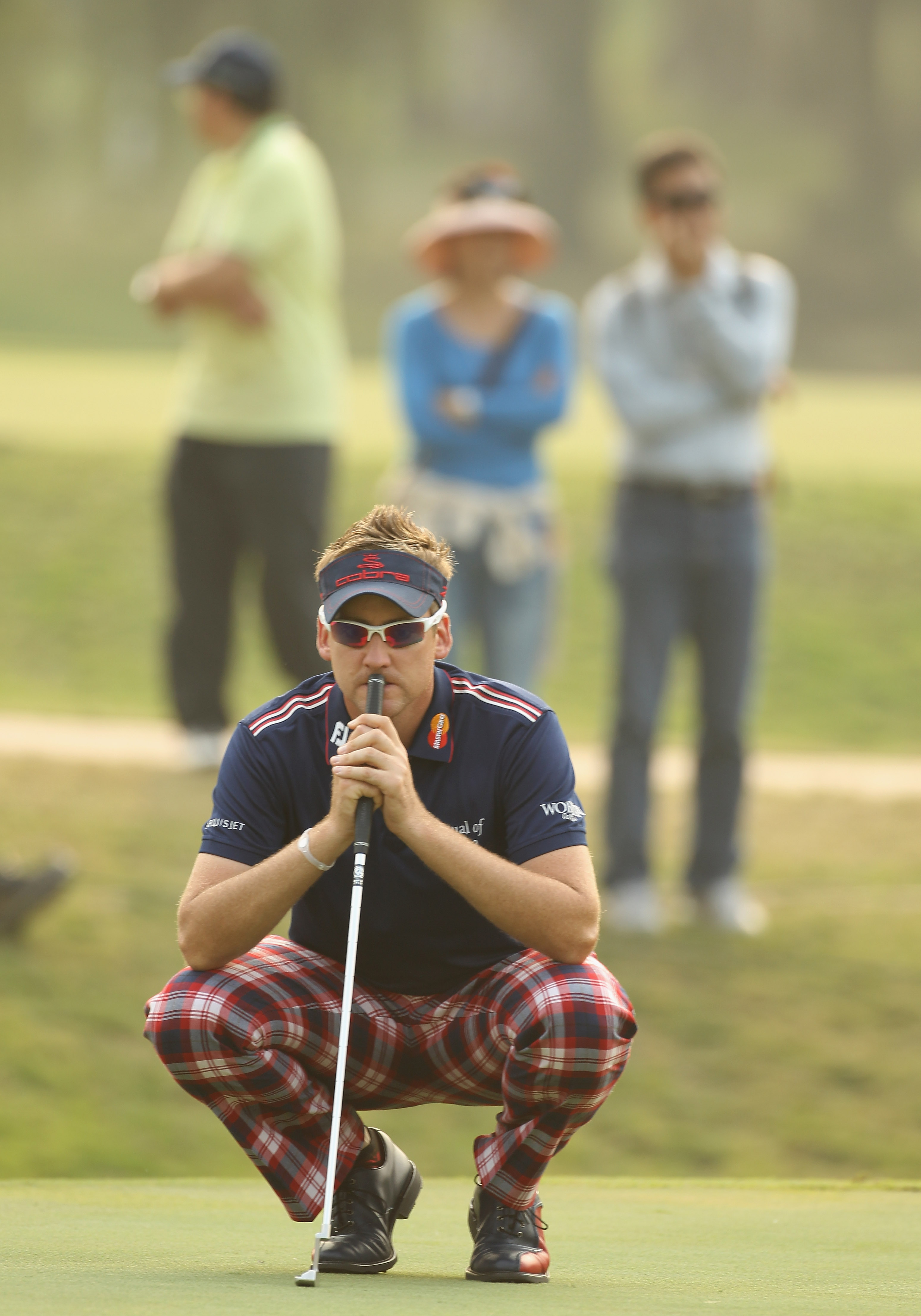 HONG KONG - NOVEMBER 19:  Ian Poulter of England  lines up a putt on the 18th green during day two of the UBS Hong Kong Open at The Hong Kong Golf Club on November 19, 2010 in Hong Kong, Hong Kong.  (Photo by Ian Walton/Getty Images)