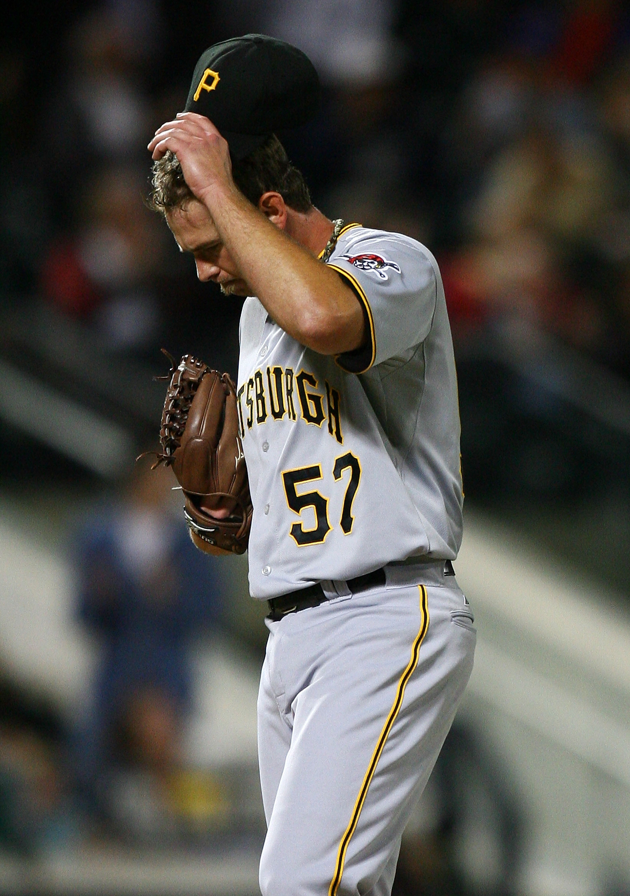NEW YORK - SEPTEMBER 14:  Zach Duke #57 of the Pittsburgh Pirates reacts after allowing a home run against the New York Mets on September 14, 2010 at Citi Field in the Flushing neighborhood of the Queens borough of New York City.  (Photo by Andrew Burton/