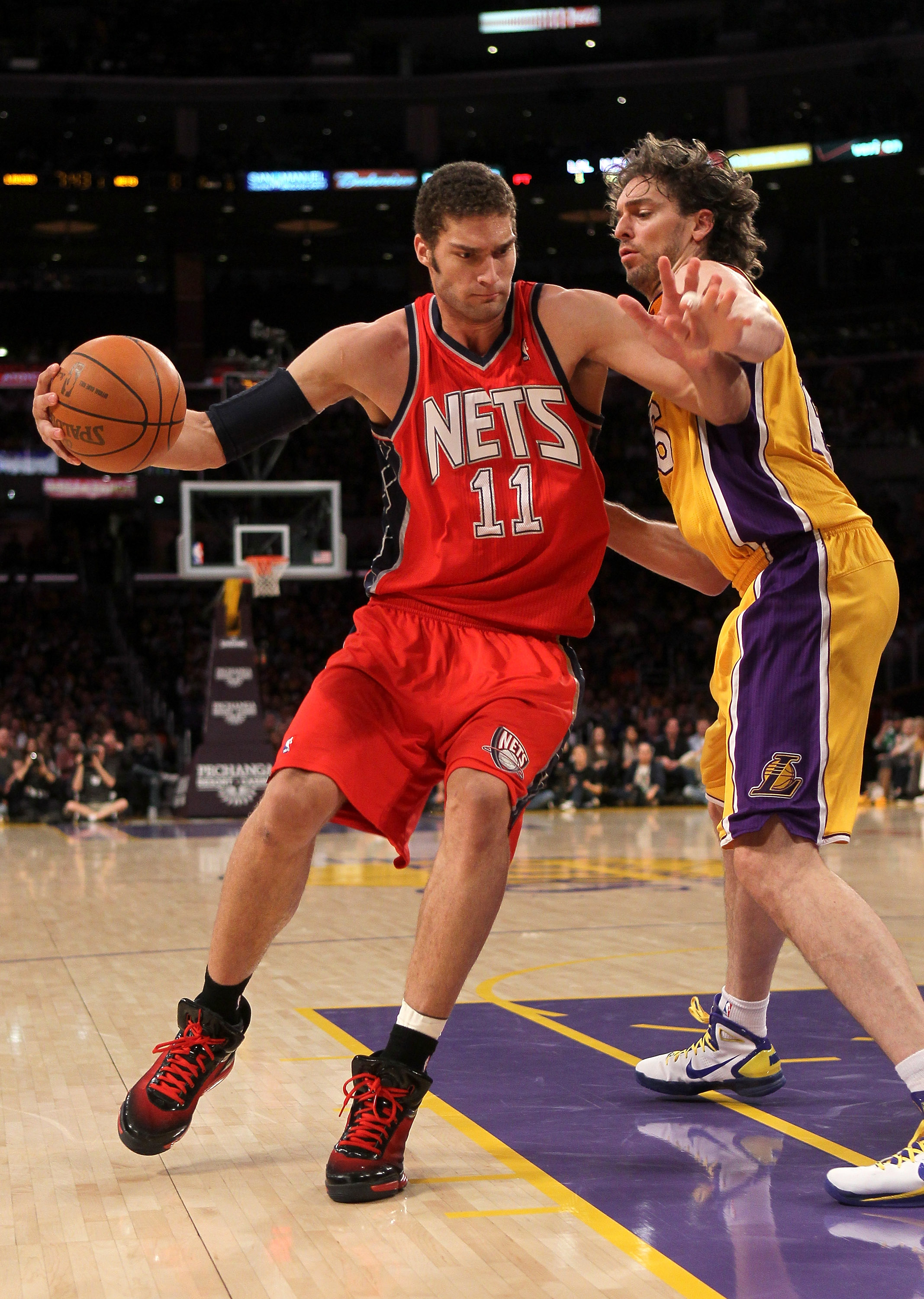 LOS ANGELES, CA - JANUARY 14:  Brook Lopez #11 of the New Jersey Nets drives against Pau Gasol #16 of the Los Angeles Lakers at Staples Center on January 14, 2011 in Los Angeles, California. The Lakers won 100-88.  NOTE TO USER: User expressly acknowledge