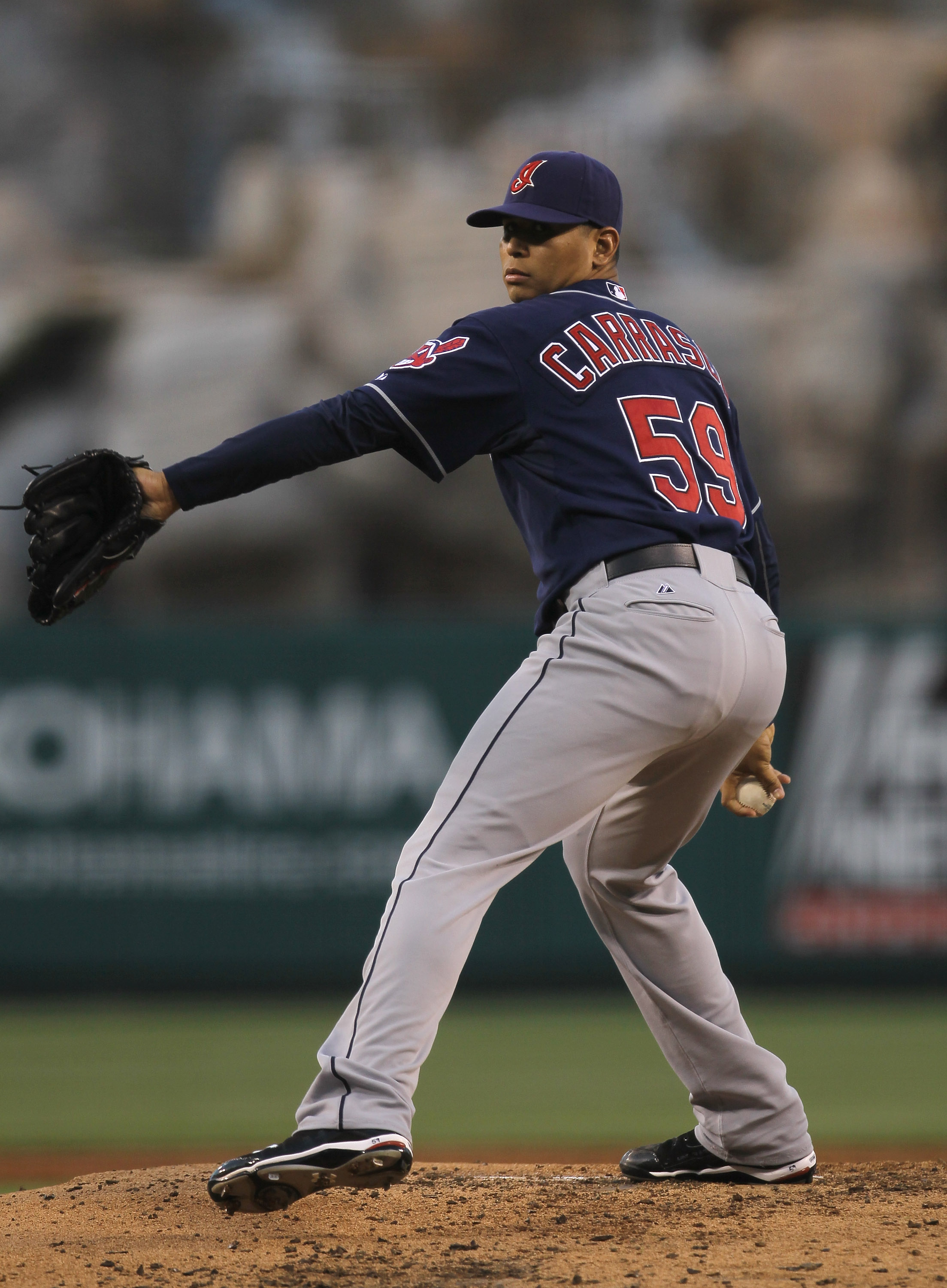 ANAHEIM, CA - SEPTEMBER 06:  Carlos Carrasco #59 of the Cleveland Indians throws a pitch against the Los Angeles Angels of Anaheim on September 6, 2010 at Angel Stadium in Anaheim, California.  (Photo by Stephen Dunn/Getty Images)