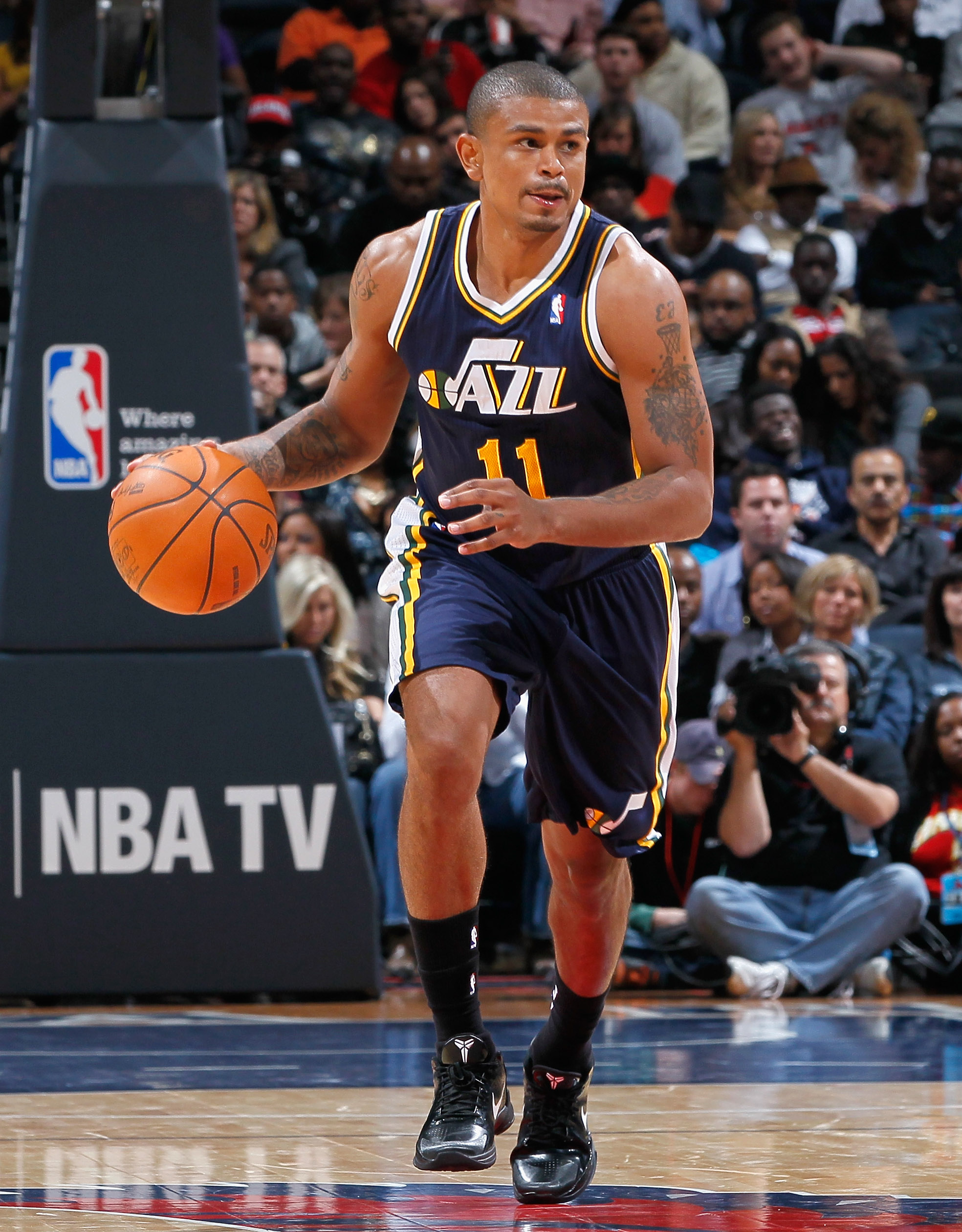 ATLANTA - NOVEMBER 12:  Earl Watson #11 of the Utah Jazz against the Atlanta Hawks at Philips Arena on November 12, 2010 in Atlanta, Georgia.  NOTE TO USER: User expressly acknowledges and agrees that, by downloading and/or using this Photograph, User is