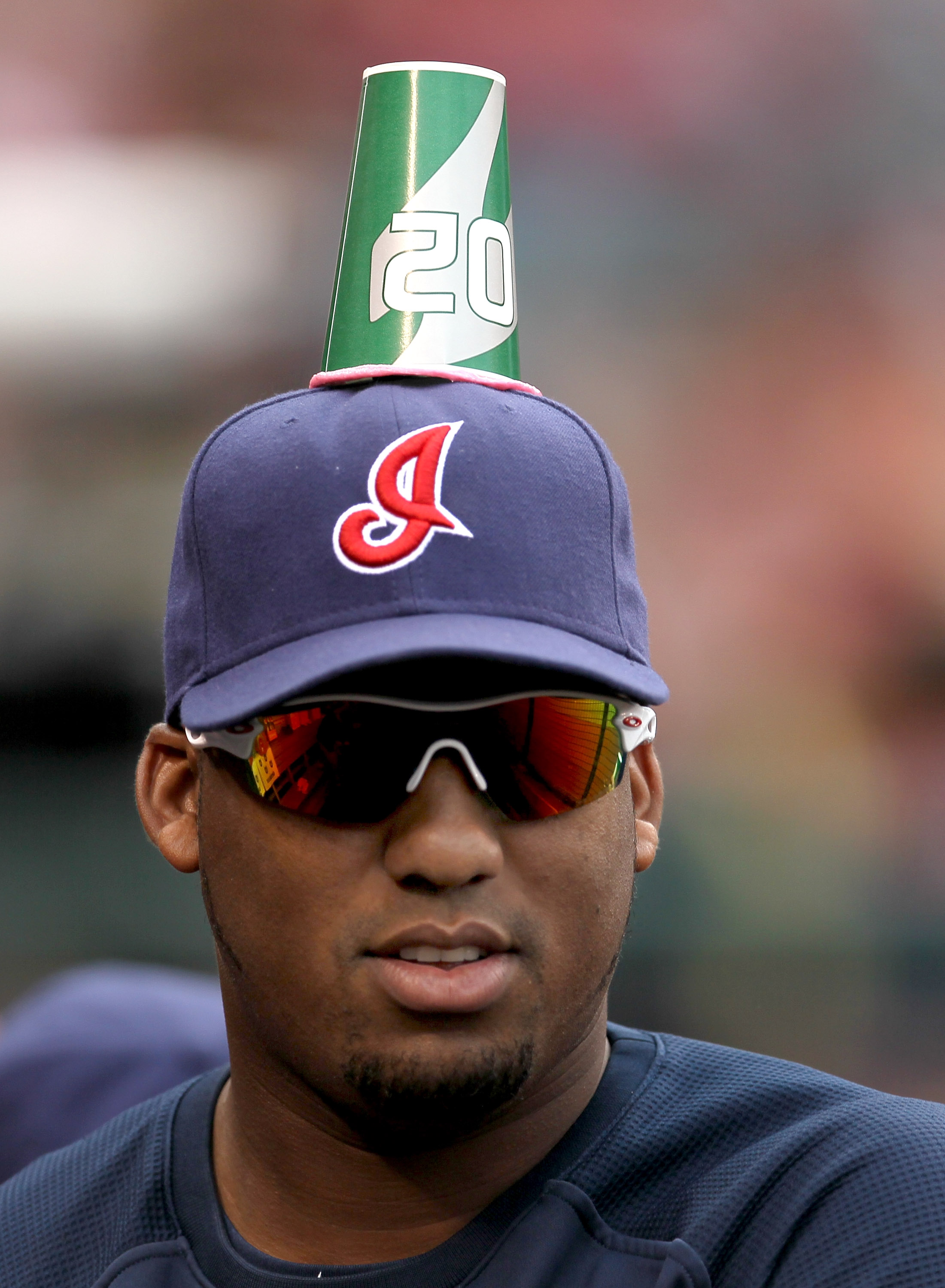 ANAHEIM, CA - SEPTEMBER 8:  Pitcher Fausto Carmona #55 of the Cleveland Indians unknowingly wears a paper cup stuck to his hat put there by teammates as a prank during the game with the Los Angeles Angels of Anaheim on September 8, 2010 at Angel Stadium i