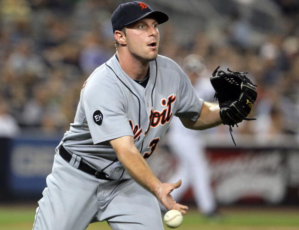 NEW YORK - AUGUST 16:  Max Scherzer #37 of the Detroit Tigers flips the ball to first base for an out against the New York Yankees on August 16, 2010 at Yankee Stadium in the Bronx borough of New York City.  (Photo by Jim McIsaac/Getty Images)