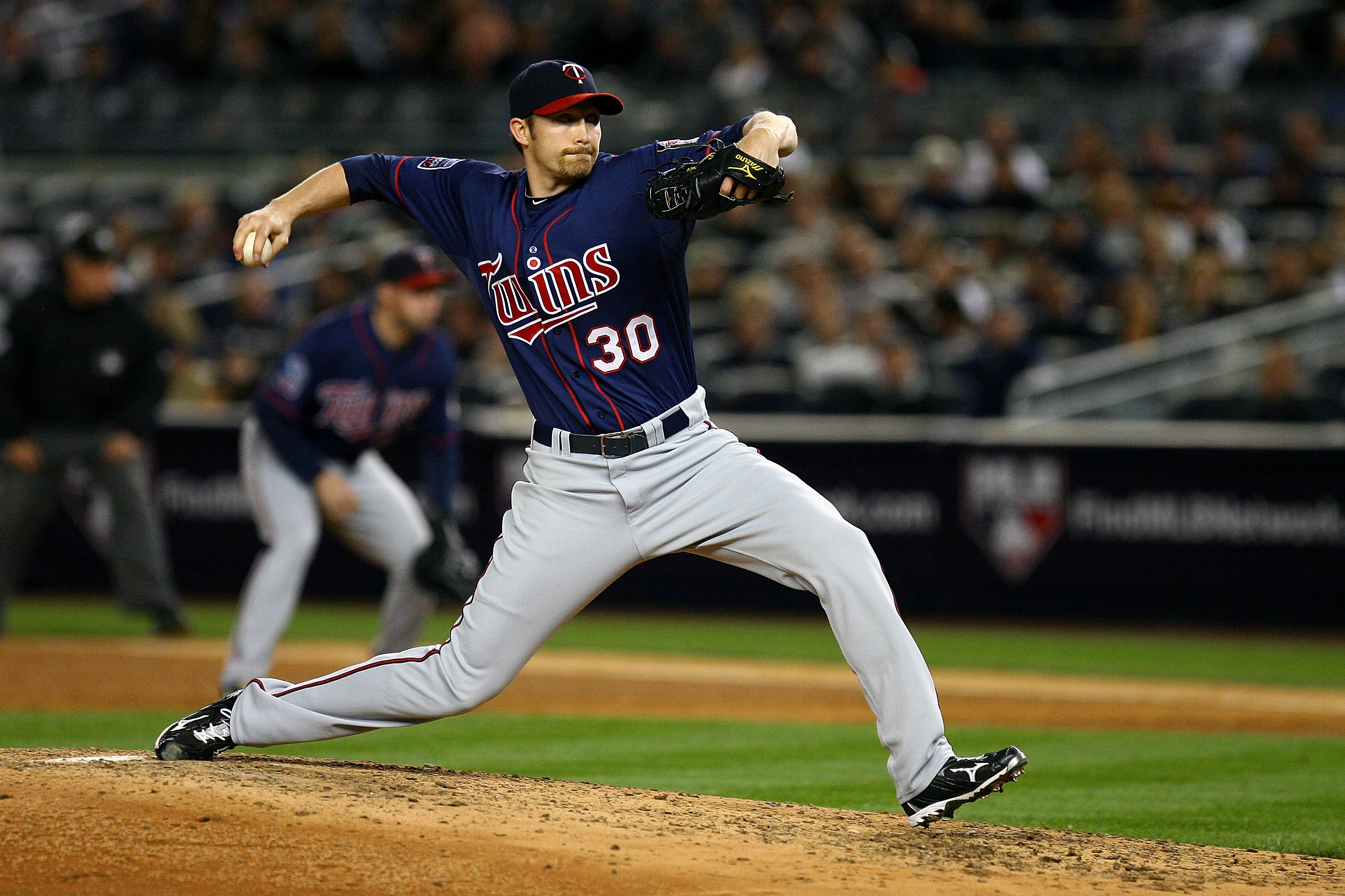 NEW YORK - OCTOBER 09:  Scott Baker #30 of the Minnesota Twins throws a pitch against the New York Yankees during Game Three of the ALDS part of the 2010 MLB Playoffs at Yankee Stadium on October 9, 2010 in the Bronx borough of New York City.  (Photo by A