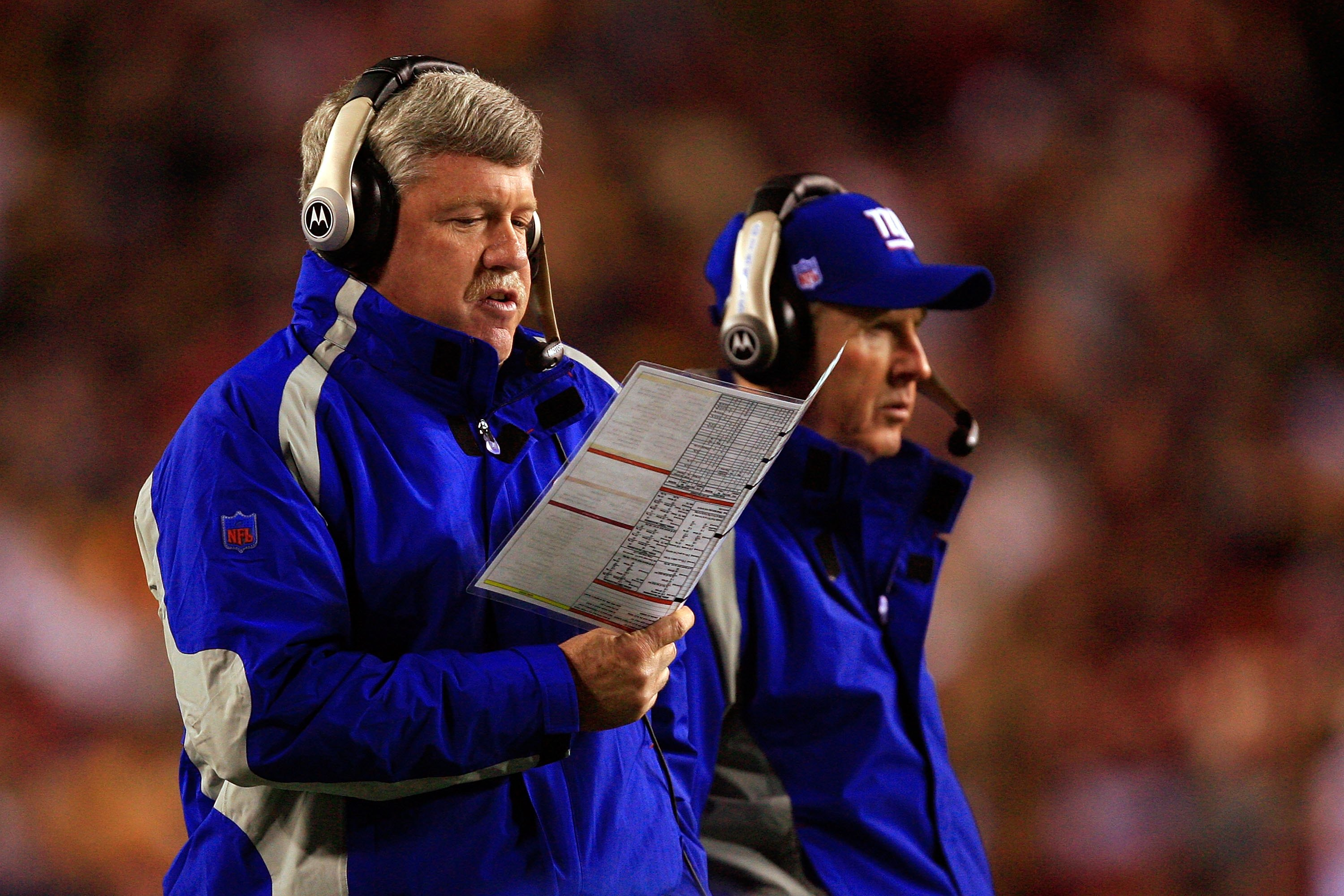 LANDOVER, MD - DECEMBER 30:  Quarterbacks coach Kevin Gilbride (L) and head coach Tom Coughlin of the New York Giants look on from the sidelines against the Washington Redskins at FedEx Field on December 30, 2006 in Landover, Maryland.  (Photo by Jamie Sq