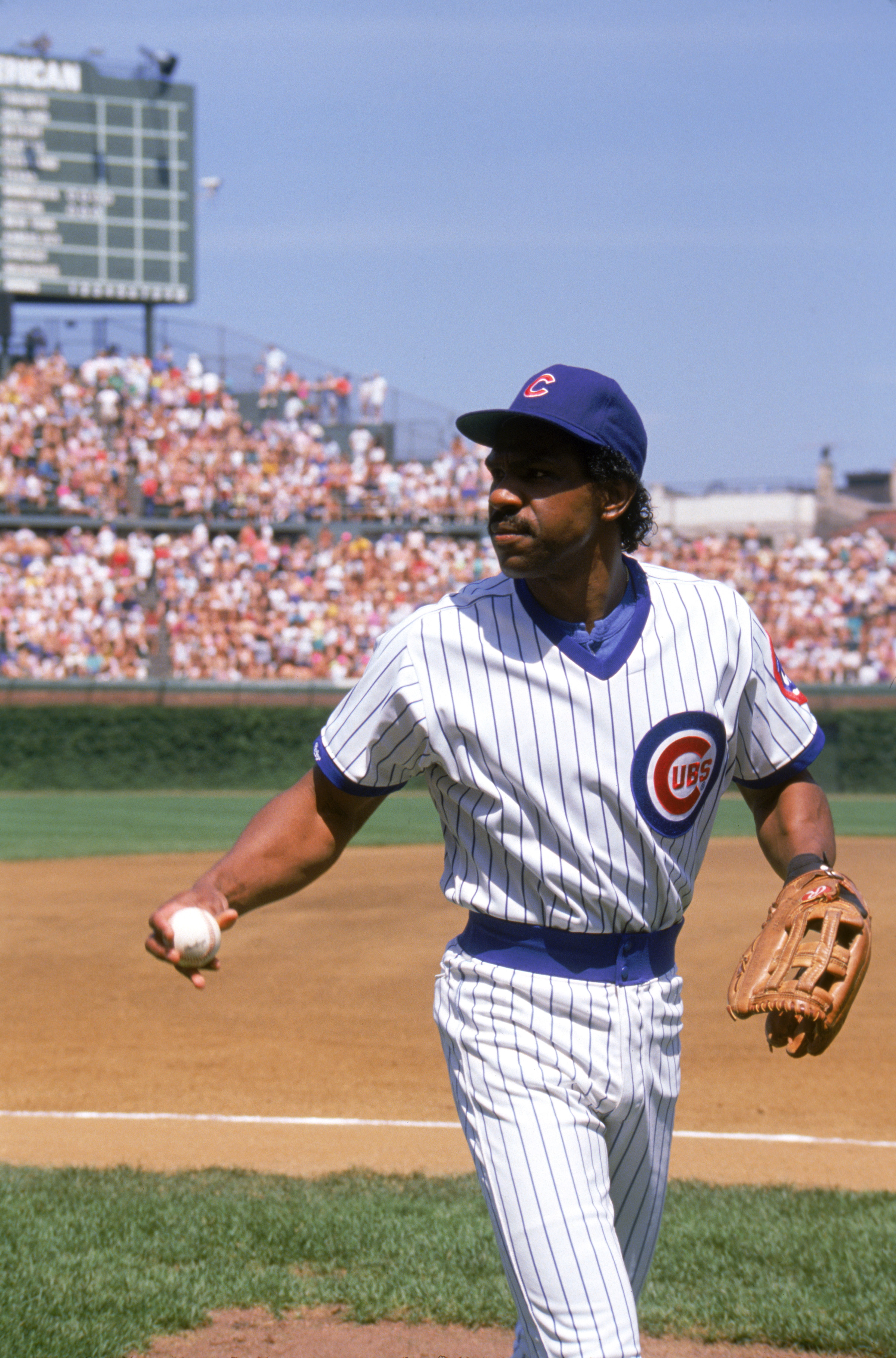 CHICAGO - 1989:  Andre Dawson #8 of the Chicago Cubs walks on the field with a ball in his hand during a game in 1989 at Wrigley Field in Chicago, Illinois.  (Photo by Jonathan Daniel/Getty Images)