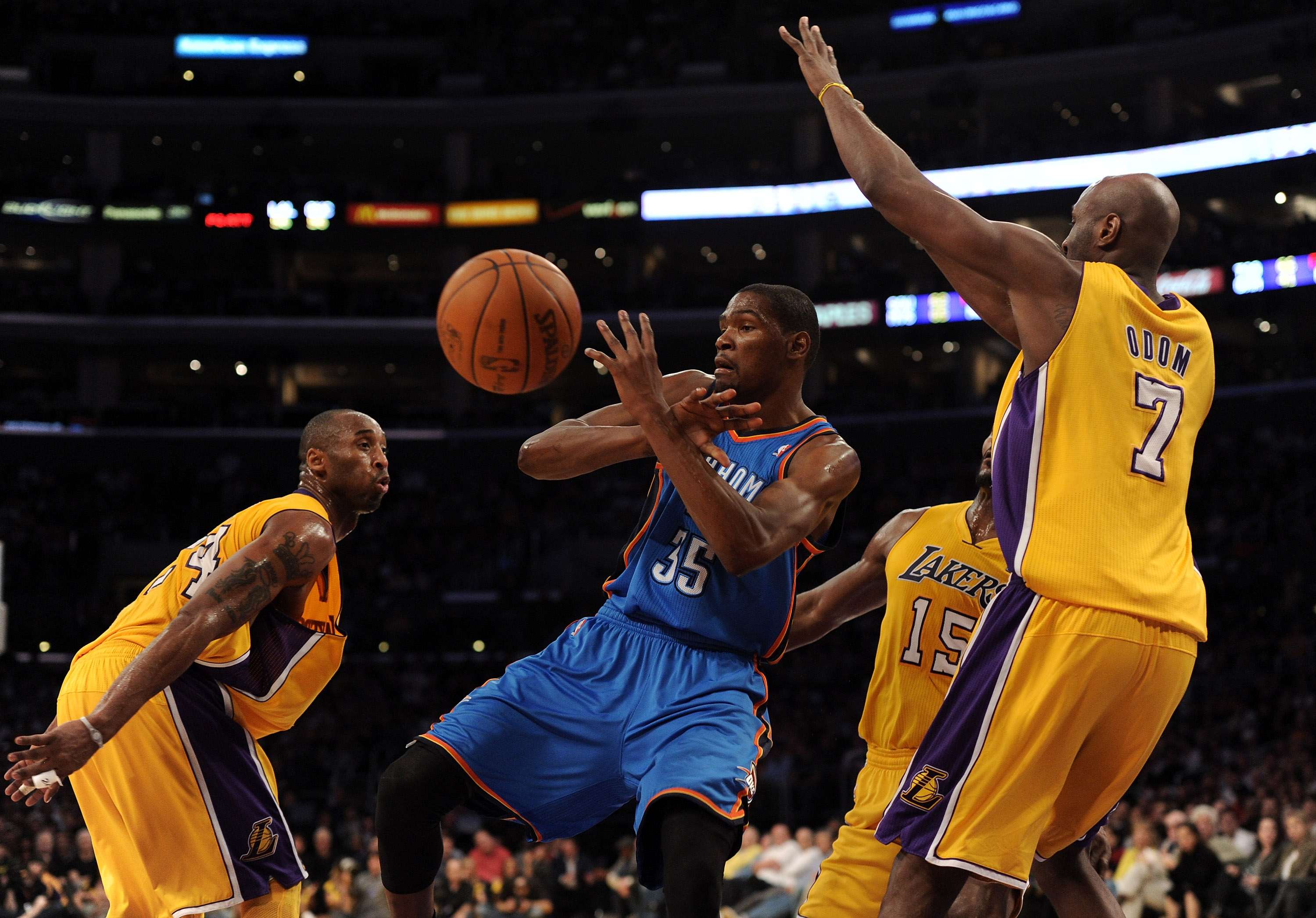 LOS ANGELES, CA - JANUARY 17:  Kevin Durant #35 of the Oklahoma City Thunder has the ball knocked away by Kobe Bryant #24 and Lamar Odom #7 of the Los Angeles Lakers at the Staples Center on January 17, 2011 in Los Angeles, California.   NOTE TO USER: Use