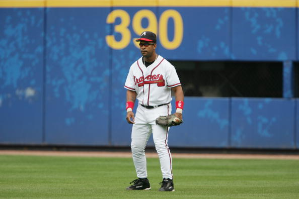ATLANTA - APRIL 13:  Outfielder Raul Mondesi #43 of the Atlanta Braves plays defense against the Washington Nationals at Turner Field on April 13, 2005 in Atlanta, Georgia.  The  Nationals defeated the Braves 11-4.  (Photo by Doug Pensinger /Getty Images)