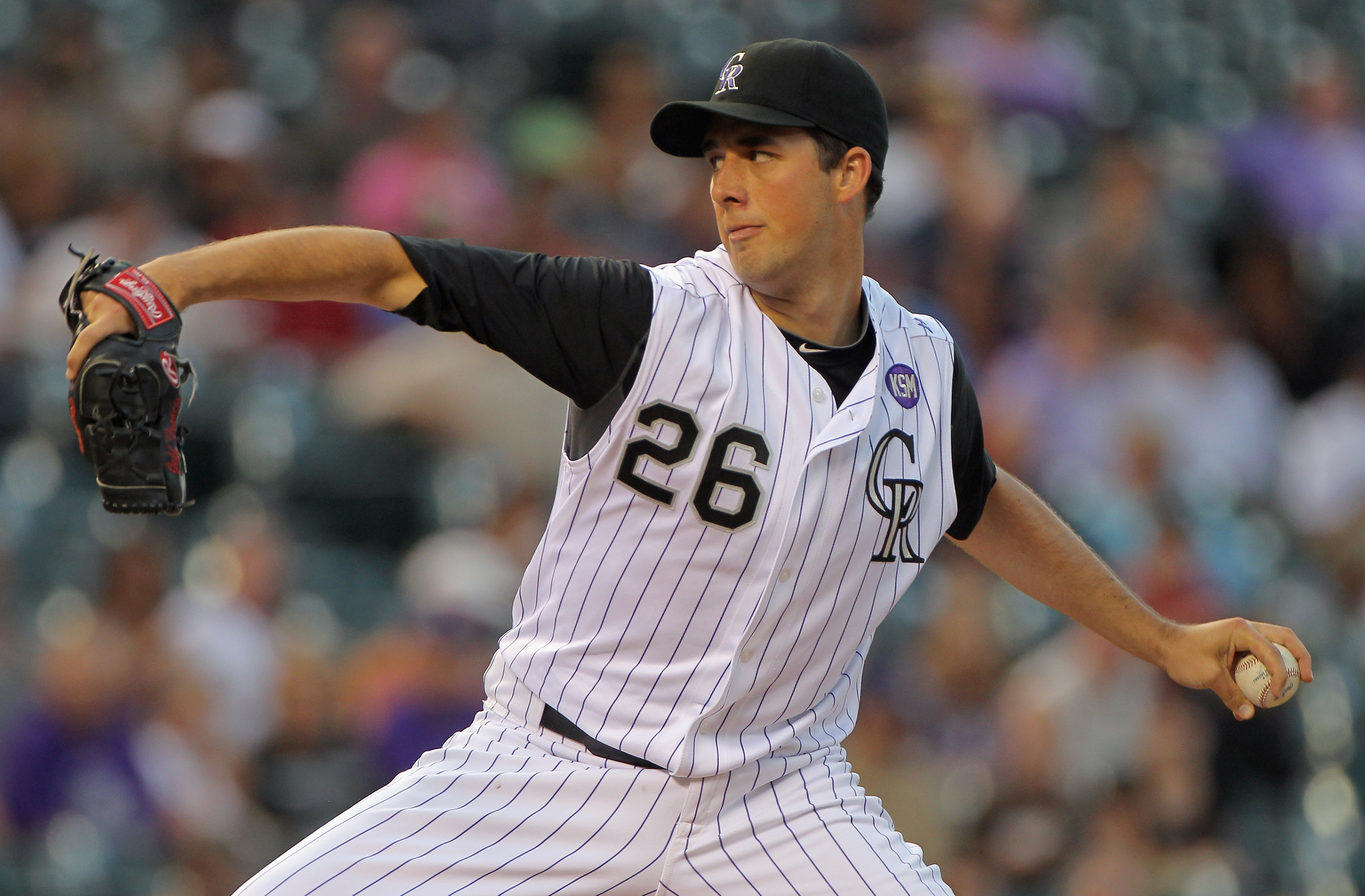 DENVER - SEPTEMBER 13:  Starting pitcher Jeff Francis #26 of the Colorado Rockies delivers against the San Diego Padres at Coors Field on September 13, 2010 in Denver, Colorado.  (Photo by Doug Pensinger/Getty Images)