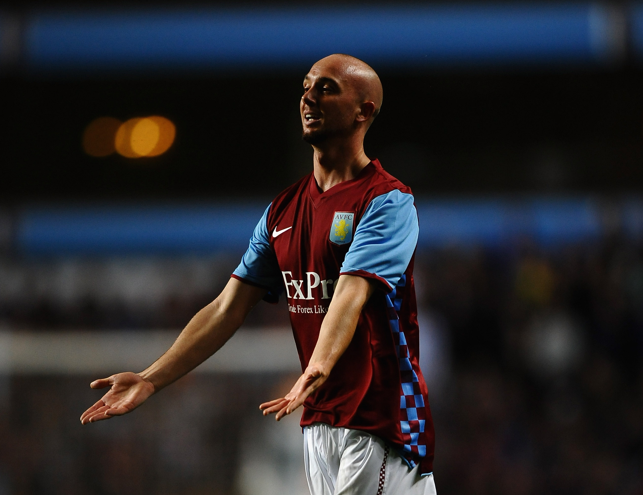 BIRMINGHAM, ENGLAND - AUGUST 26:  Stephen Ireland of Aston Villa shows his frustrations during the UEFA Europa League  Play Off, second leg match between Aston Villa and SK Rapid Vienna at Villa Park on August 26, 2010 in Birmingham, England.  (Photo by L