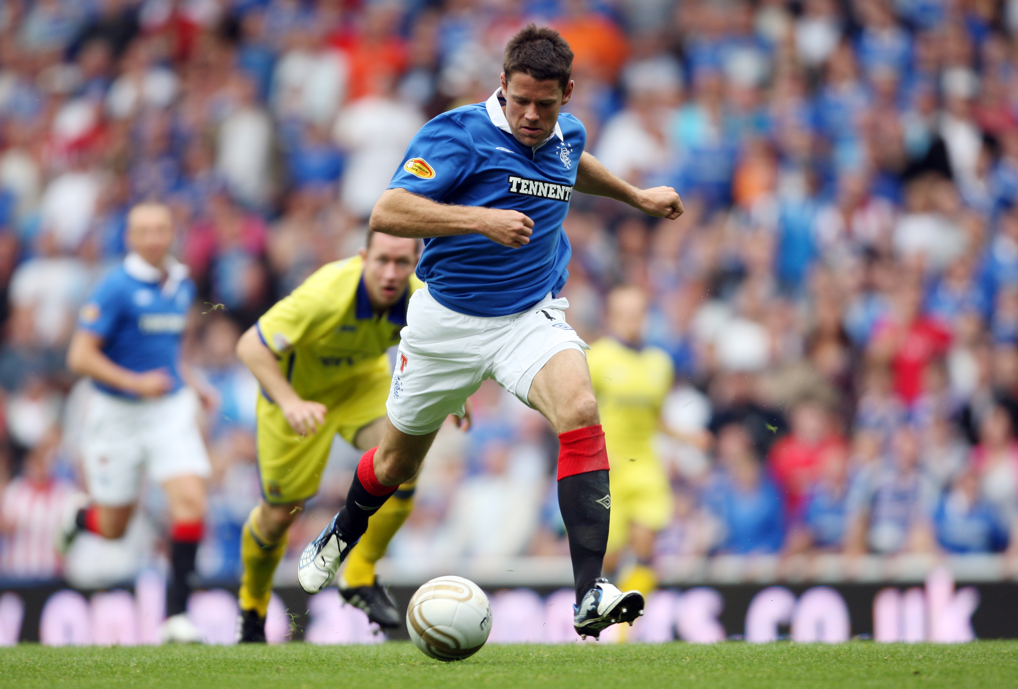 GLASGOW, UNITED KINGDOM - AUGUST 14:  James Beattie of Glasgow Rangers running through on goal during the Clydesdale Bank Scottish Premier League match between Glasgow Rangers and Kilmarnock at Ibrox Stadium on August 14, 2010 in Glasgow, Scotland. (Photo