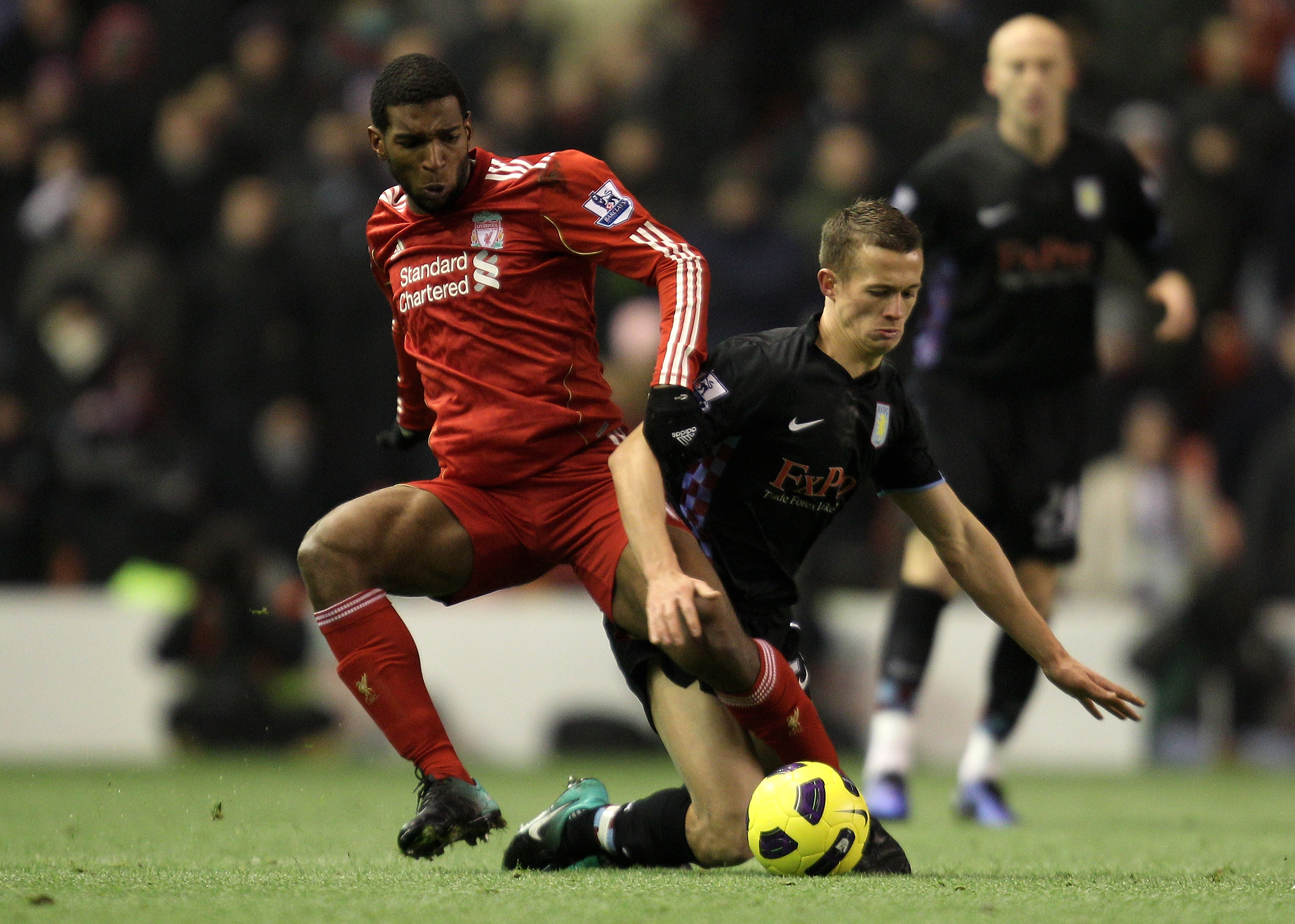 LIVERPOOL, ENGLAND - DECEMBER 06:  Ryan Babel of Liverpool tangles with Jonathan Hogg of Aston Villa during the Barclays Premier League match between Liverpool and Aston Villa at Anfield on December 6, 2010 in Liverpool, England.  (Photo by Mark Thompson/