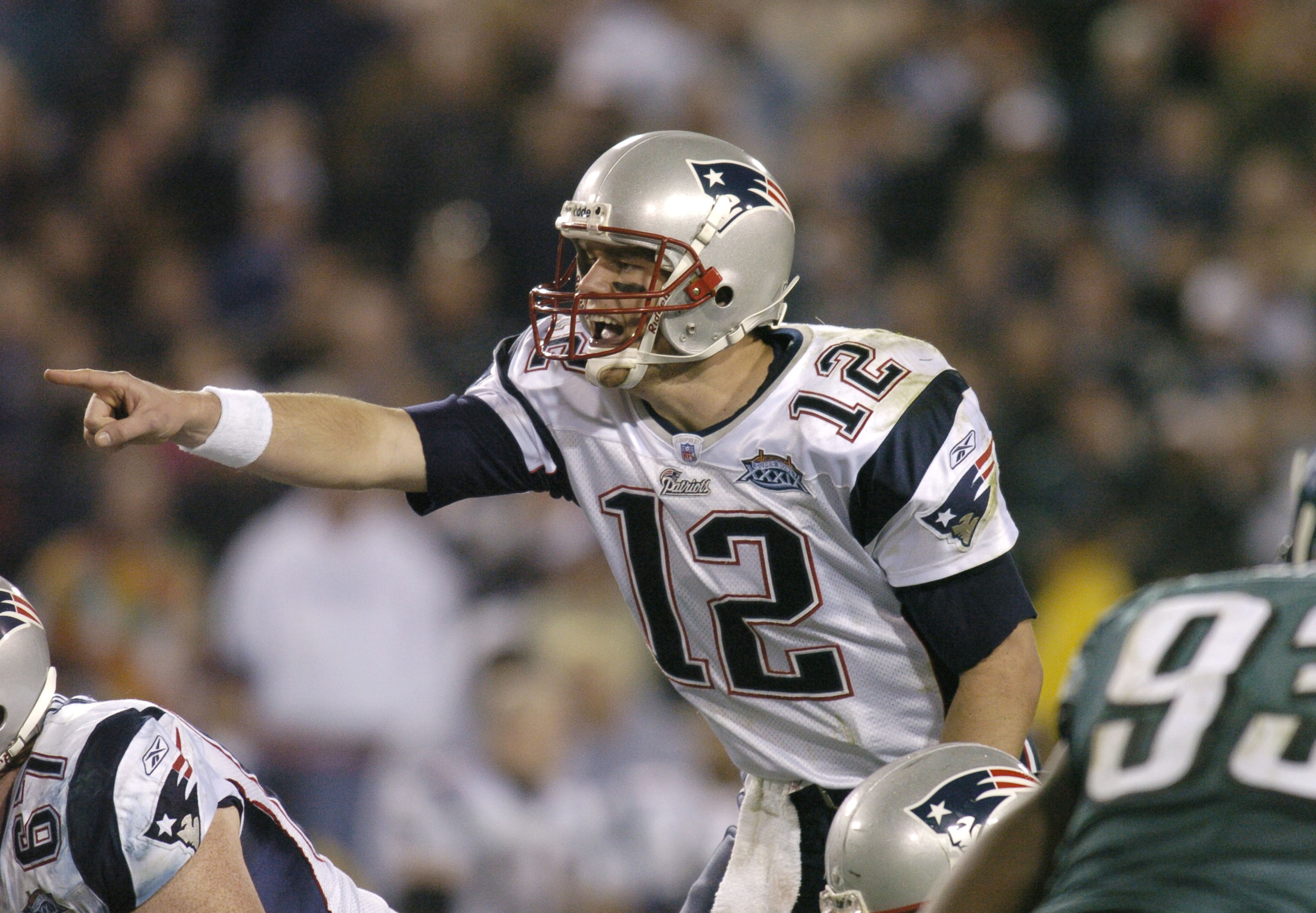 New England Patriots QB Tom Brady #12 makes a call during Super Bowl XXXIX between the Philadelphia Eagles and the New England Patriots at Alltel Stadium in Jacksonville, Florida on February 6, 2005.  (Photo by Al Messerschmidt/Getty Images)