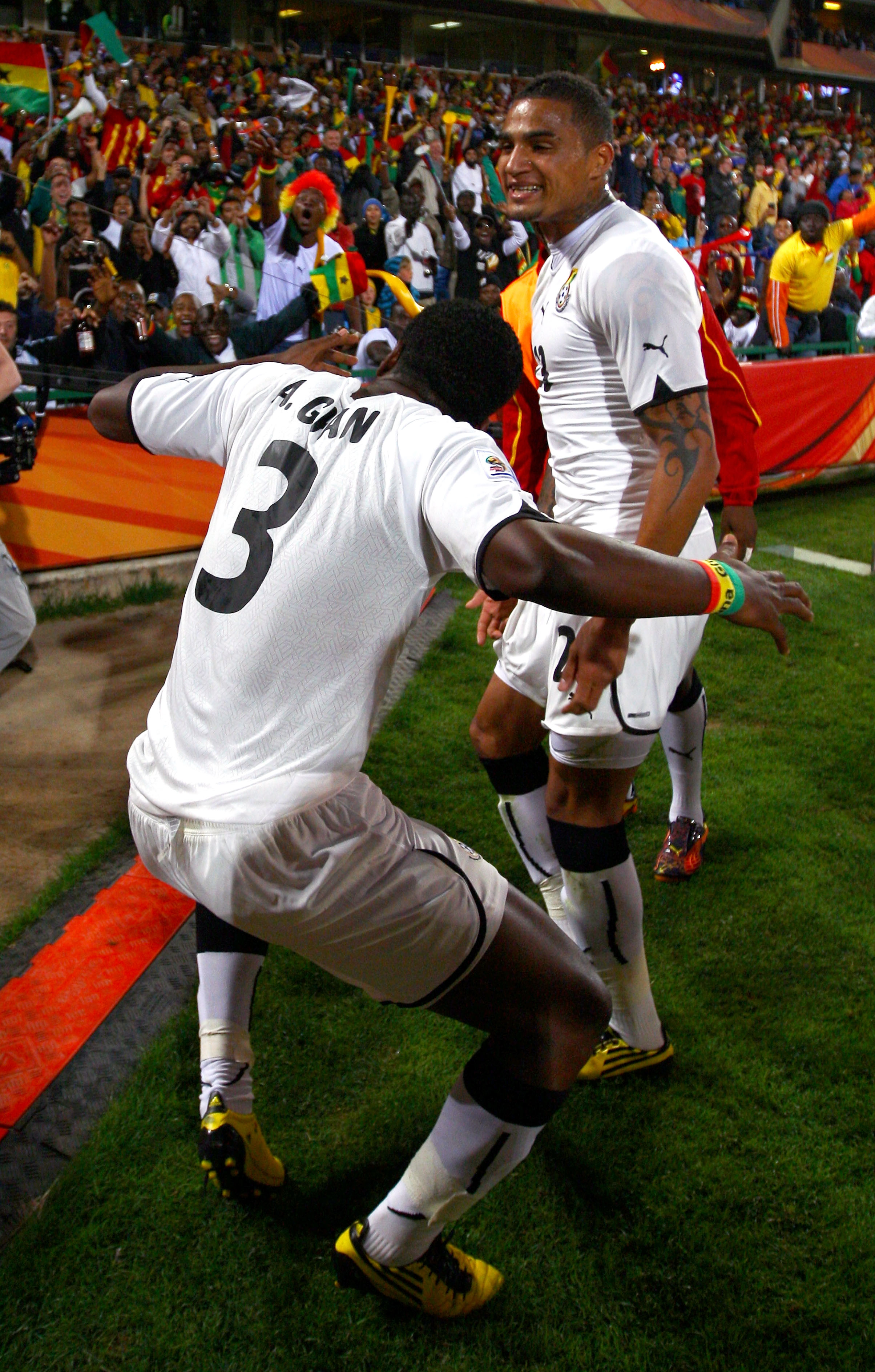 PRETORIA, SOUTH AFRICA - JUNE 13:  Kevin Prince Boateng of Ghana (R) celebrates with goalscorer Asamoah Gyan of Ghana during the 2010 FIFA World Cup South Africa Group D match between Serbia and Ghana at Loftus Versfeld Stadium on June 13, 2010 in Pretori
