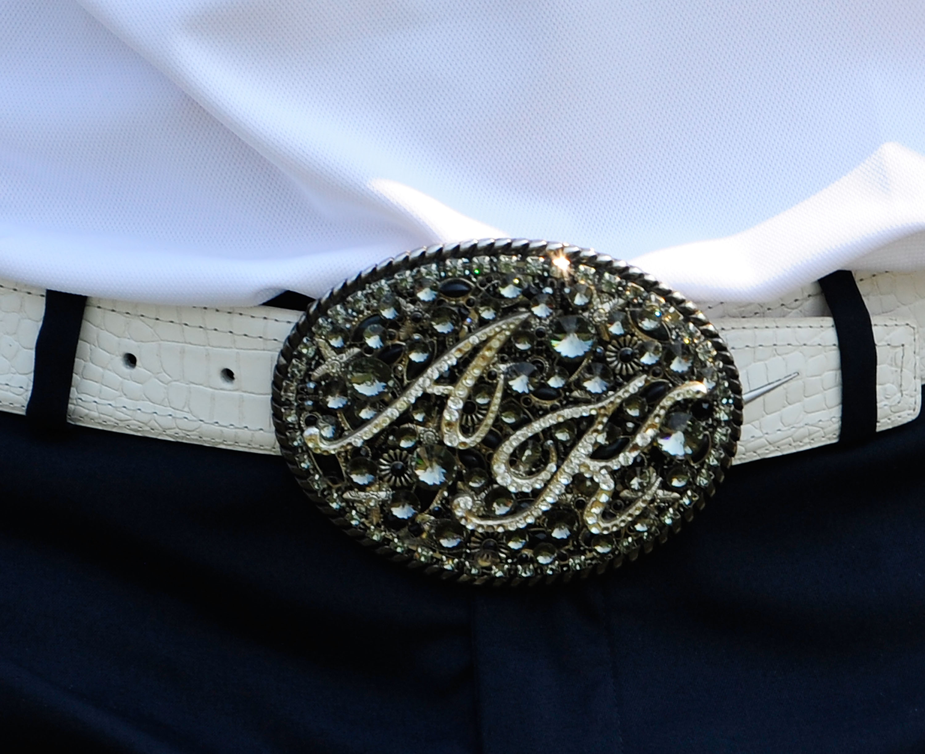 PALM BEACH GARDENS, FL - MARCH 06:  A closeup view of Anthony Kim's belt buckle during the third round of the Honda Classic at PGA National Resort And Spa on March 6, 2010 in Palm Beach Gardens, Florida.  (Photo by Sam Greenwood/Getty Images)