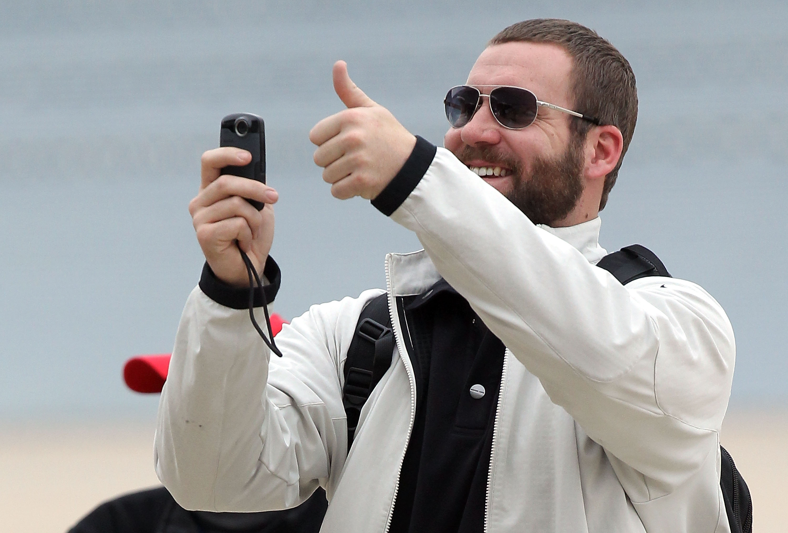 DALLAS, TX - JANUARY 31:  Quarterback Ben Roethlisberger #7 of the Pittsburgh Steelers records a video while arriving at Dallas Fort Worth International Airport on January 31, 2011 in Dallas, Texas.  The Pittsburgh Steelers will play the Green Bay Packers